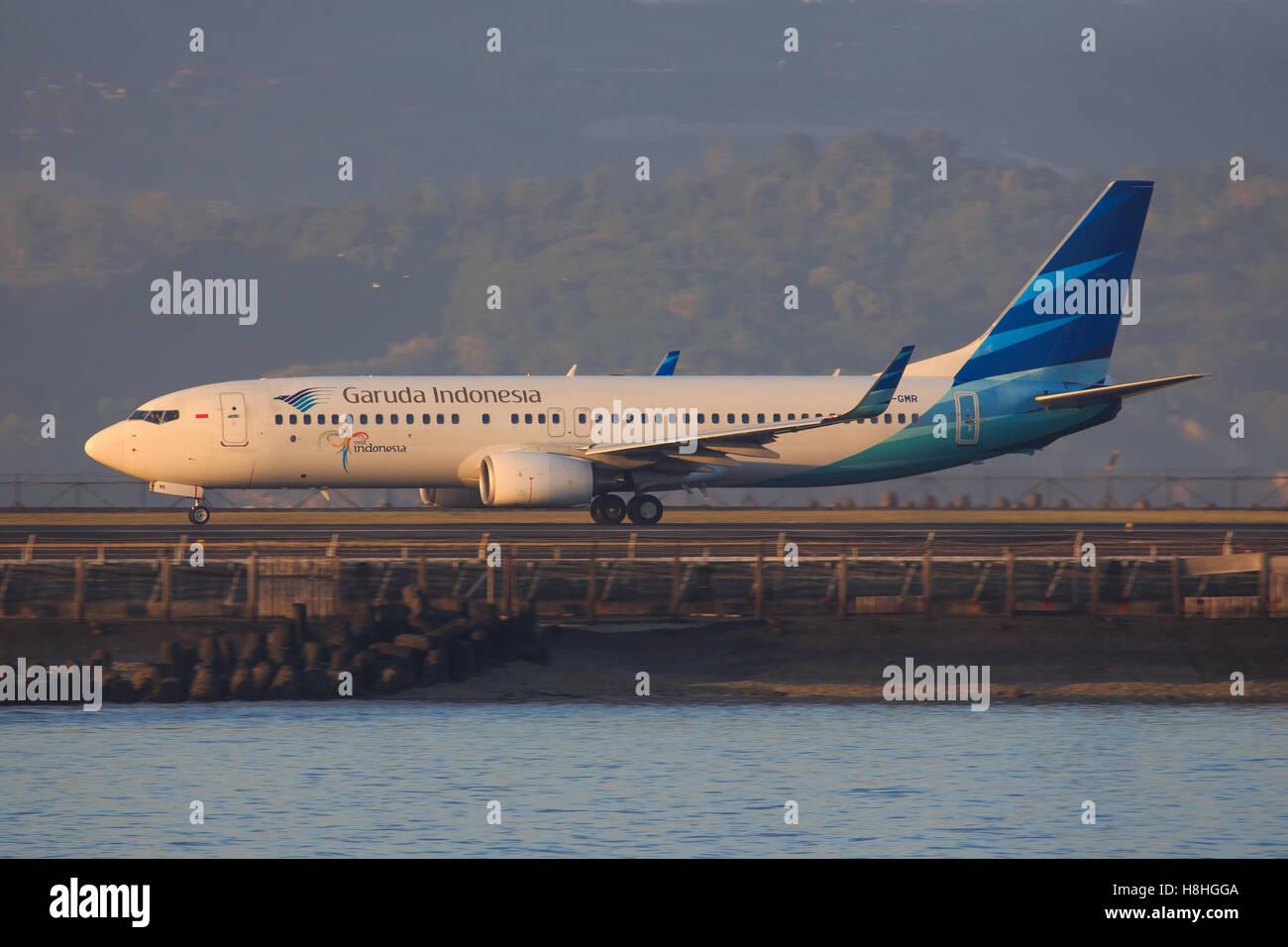 Bali/Indonesia Februar 19, 2013: Boeing 737 from Garuda Indonesia takeoff at Bali Airport. - Stock Image