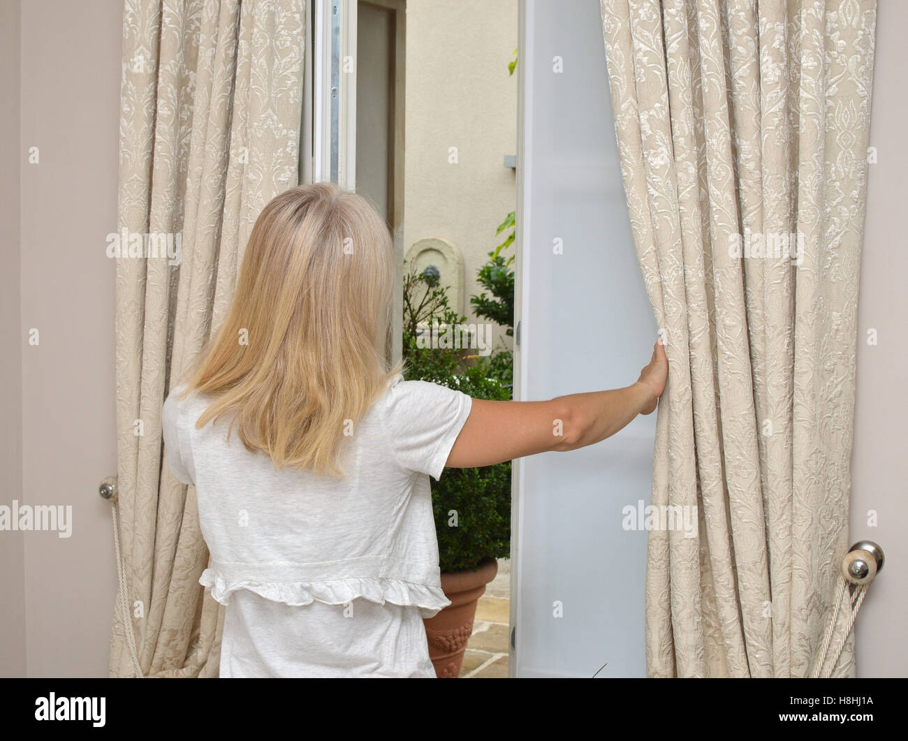 Lady In Cozy Home Wear Moving Curtains And Opening Bedroom Window Stock Photo Alamy