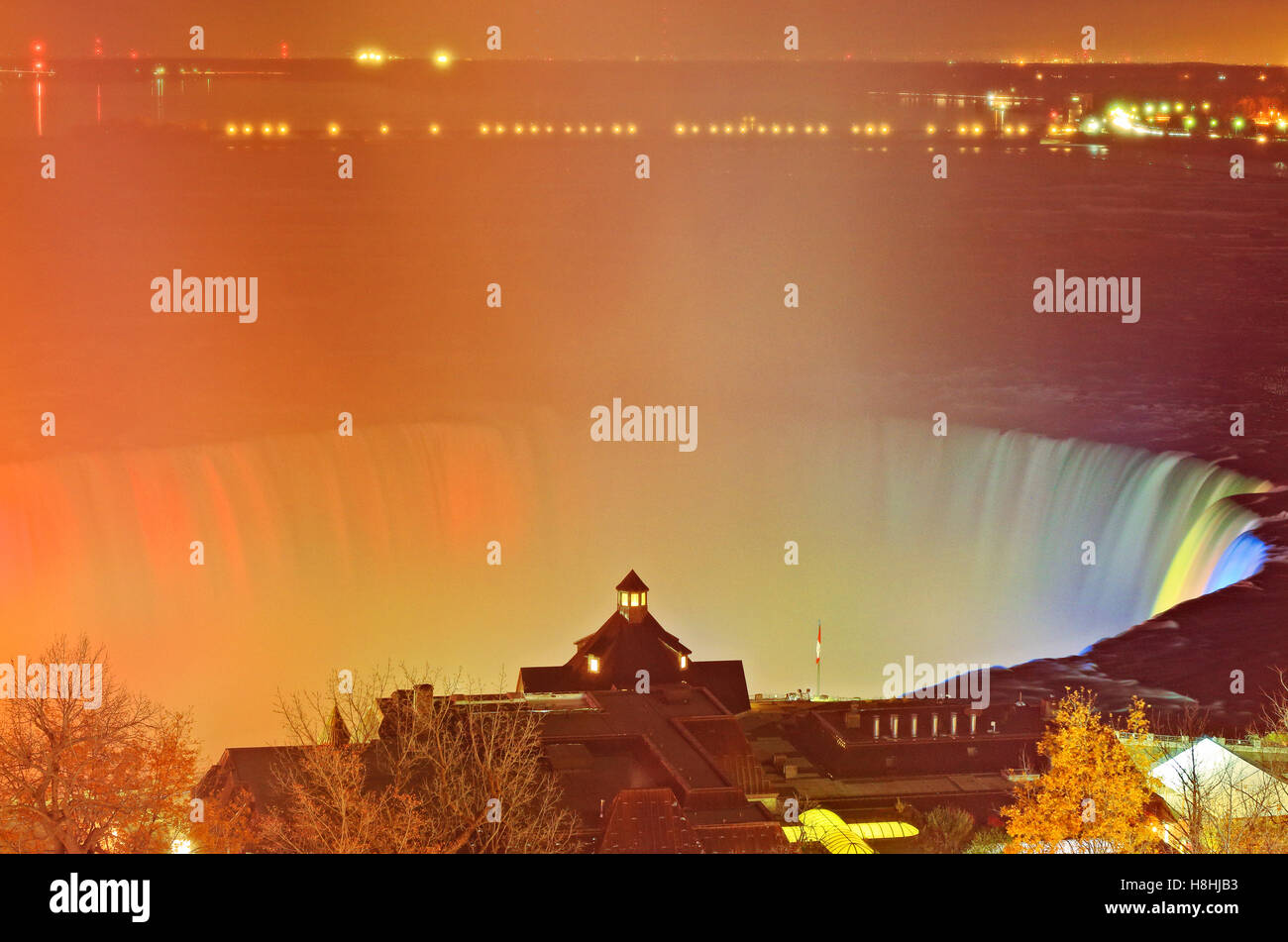 Aerial view of Niagara Falls Illumination light show of the grand Horseshoe Falls and Table Rock Welcome Centre - Stock Image