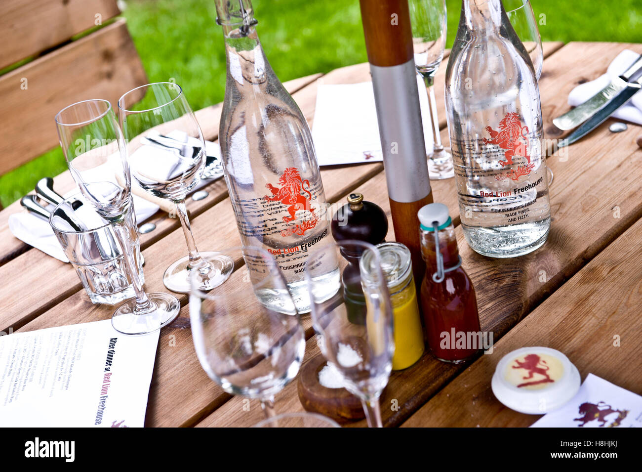 Pub garden - the red lion free house branded water The acclaimed Michelin starred Red Lion Freehouse just been awarded - Stock Image