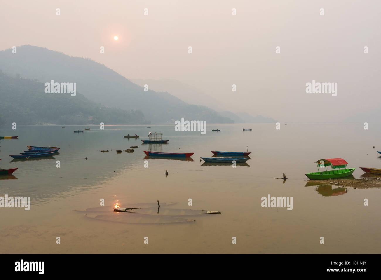 Phewa Lake by a hazy day in Pokhara, Nepal - Stock Image