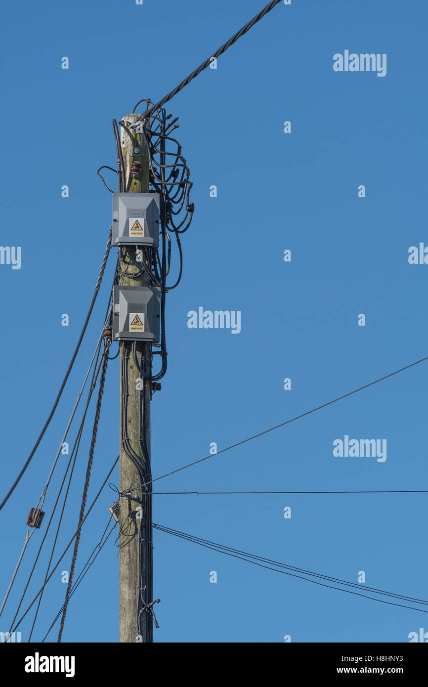 Electrical Power Distribution Pole And Junction Boxes Delivering Home Wiring Box Household Electricity Set Against Blue Sky