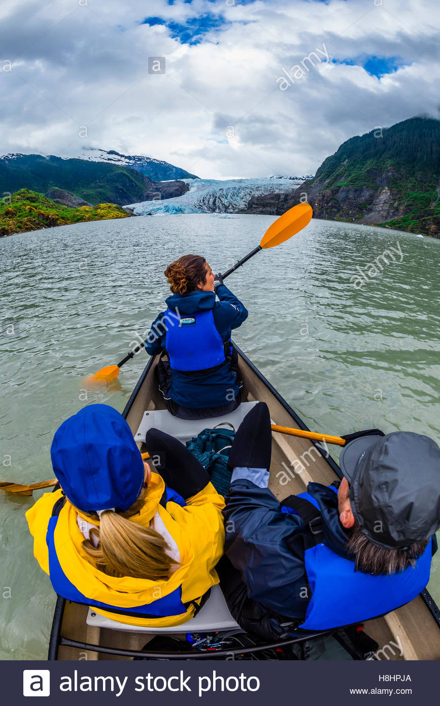 Canoeing on Mendenhall Lake with Mendenhall Glacier in background, Juneau, Alaska USA. Stock Photo