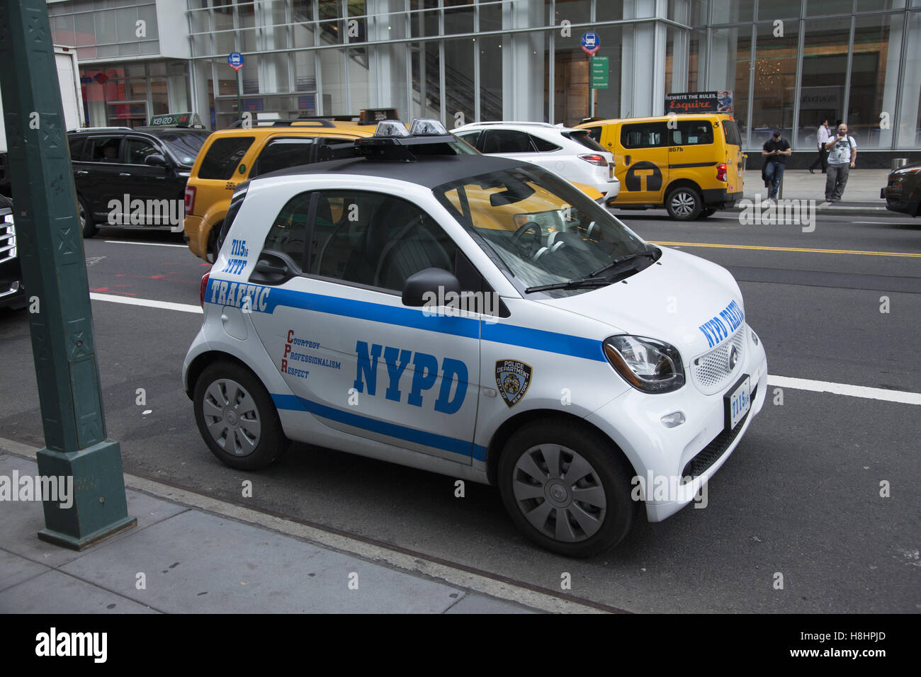 new york police department nypd mini car used in the traffic stock photo 125780773 alamy. Black Bedroom Furniture Sets. Home Design Ideas