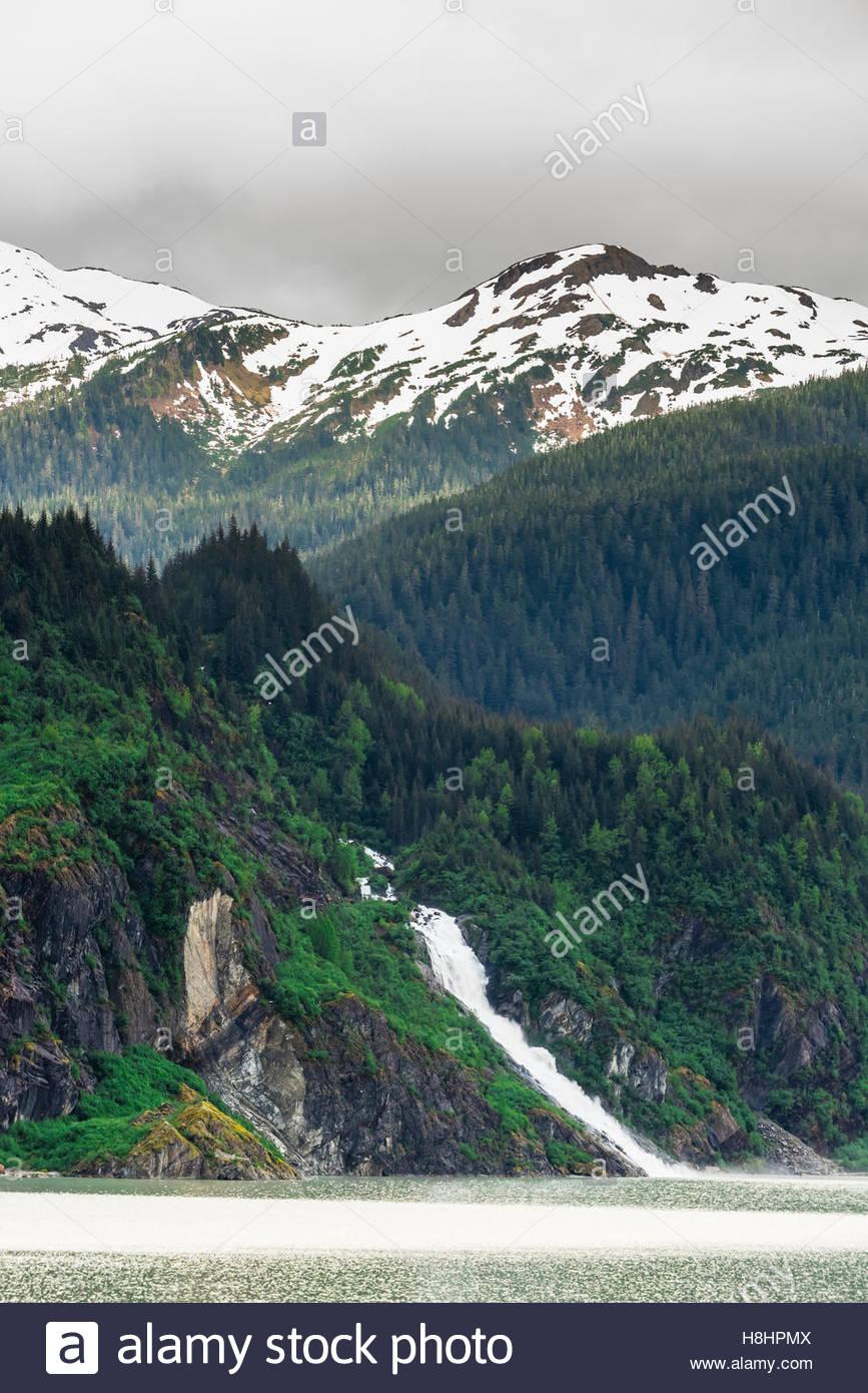 377 foot tall (115 meters) Nugget Creek Falls (aka Mendenhall Glacier Falls), Mendenhall Lake, near Juneau, Alaska - Stock Image