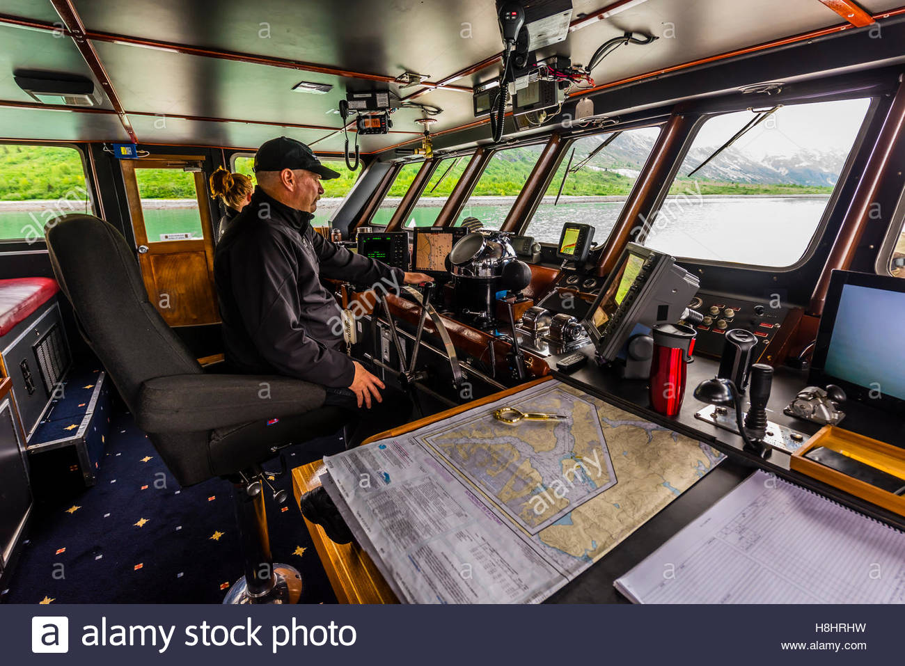 Ship's captain on the bridge, Wilderness Explorer (small cruise ship), Glacier Bay National Park (a UNESCO World - Stock Image