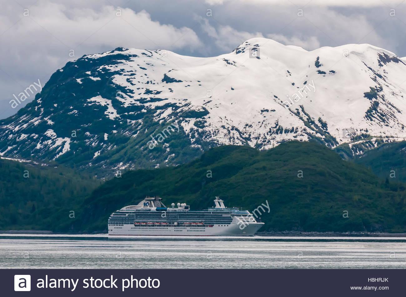 Coral Princess cruise ship sailing through Glacier Bay National Park (a UNESCO World Heritage Site), Alaska USA. - Stock Image