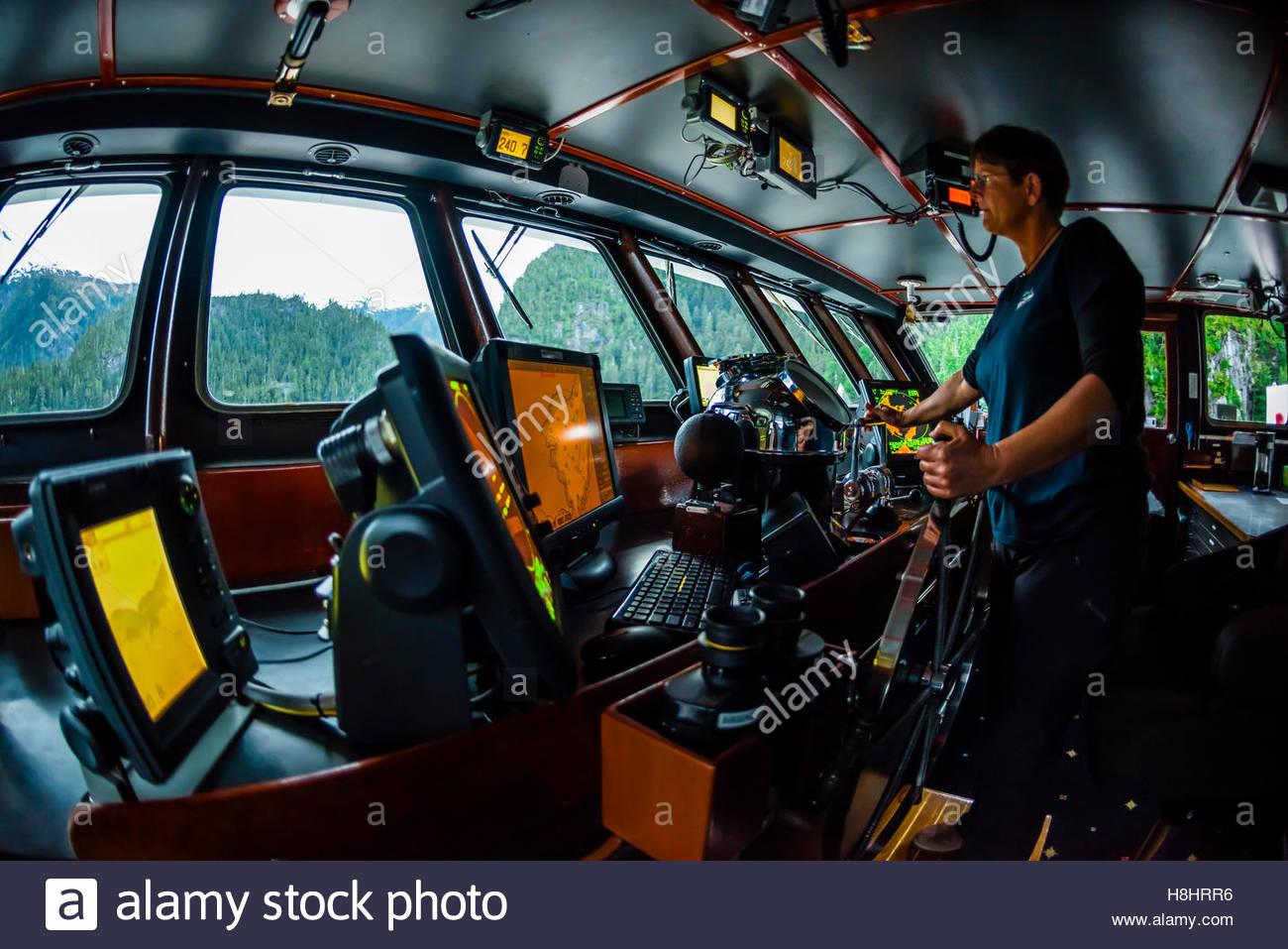 On the bridge of the Wilderness Explorer (small cruise ship), Inside Passage, Southeast Alaska USA. - Stock Image