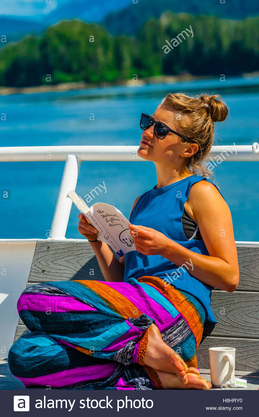 Relaxing aboard the Wilderness Exploerer (small cruise ship), Magoun Islands State Marine Park, Krestof Sound,  - Stock Image