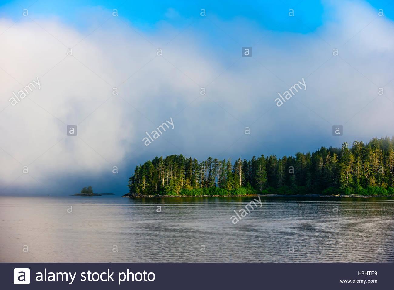 Fog and low hanging clouds, Sitka Sound,  Inside Passage, near Sitka, Alaska USA. - Stock Image