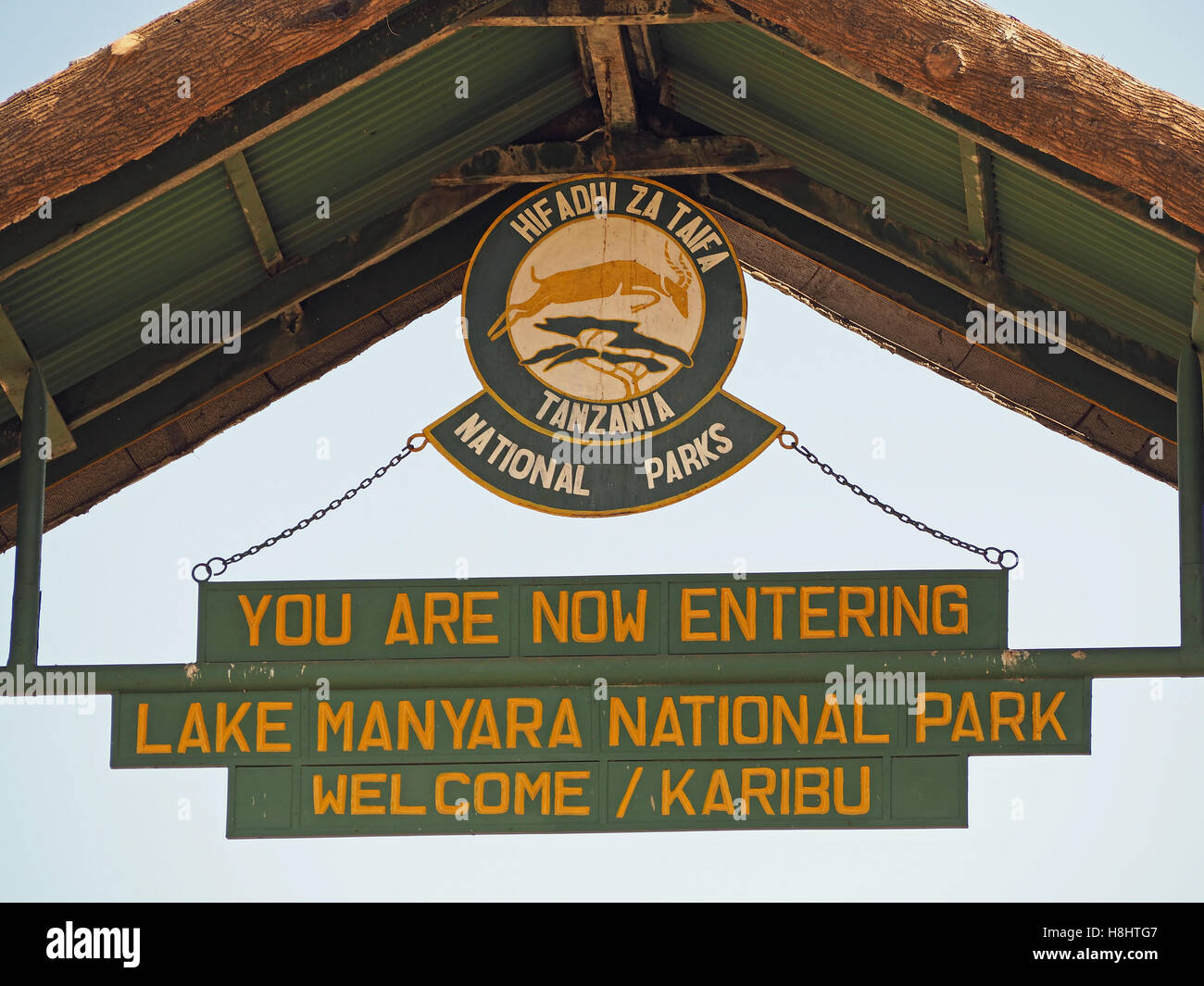 View looking up at the sign hanging over the entrance to the Lake Manyara National Park in Tanzania Africa - Stock Image