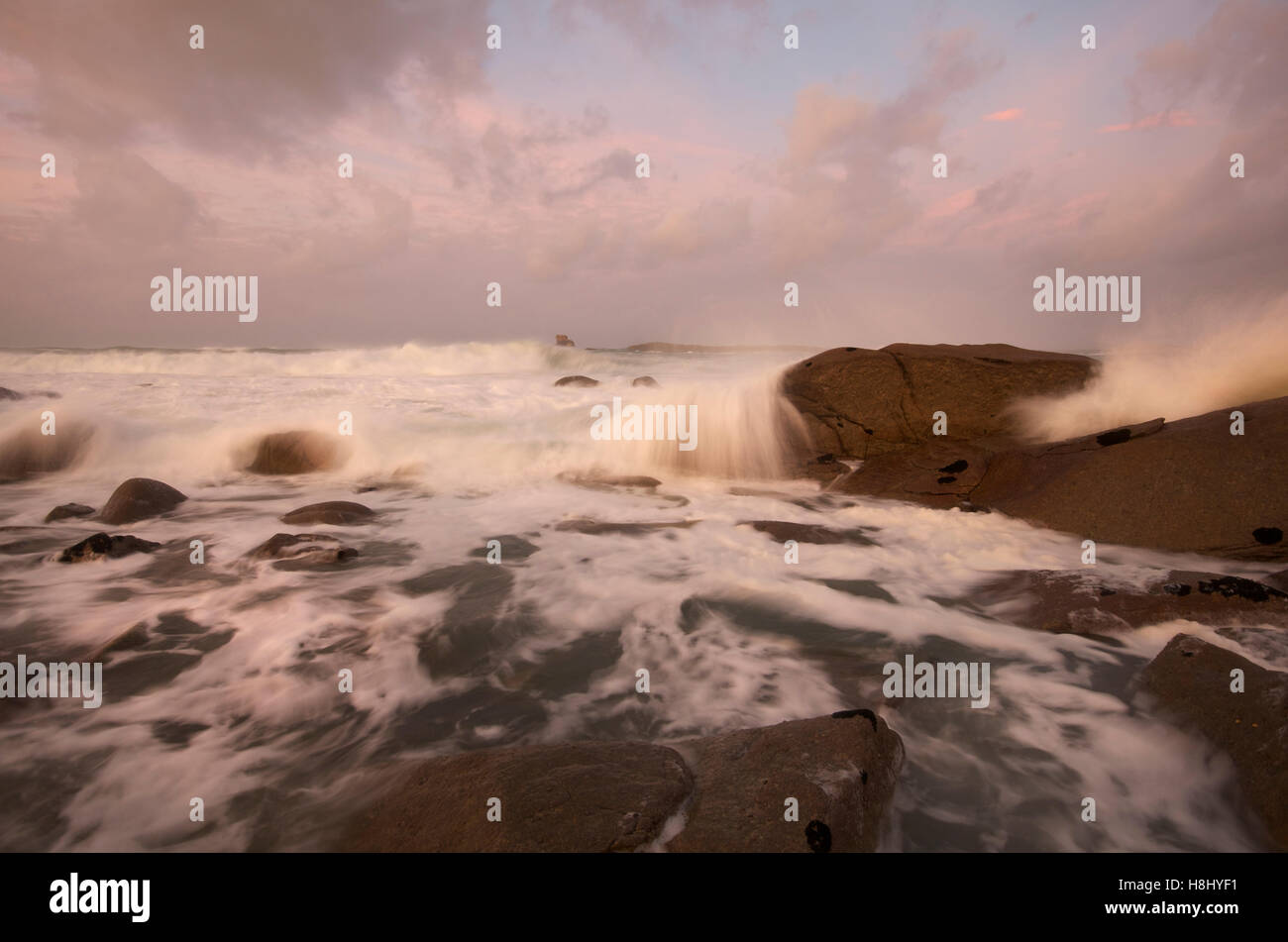 Tide rushing in at Ile Grande, Cotes d'Armor, France - Stock Image
