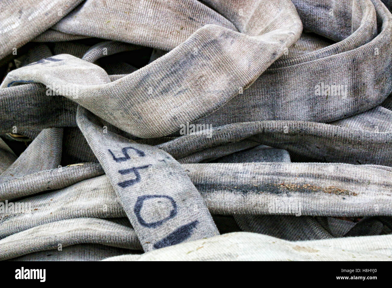 Pile of intertwined Fire Hose - Stock Image