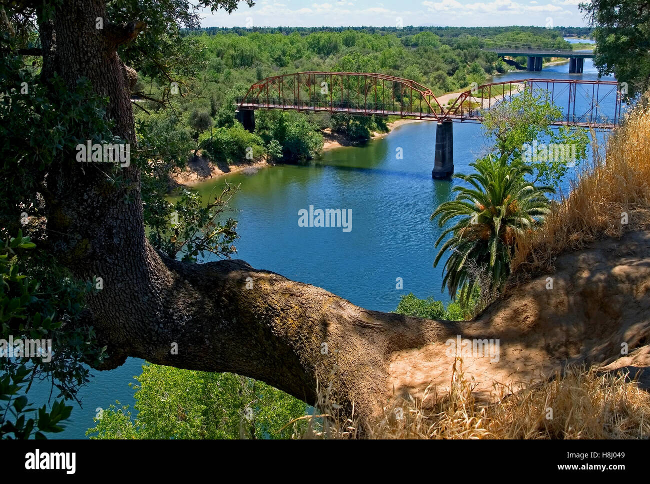 Old Red Bridge over the American River in Fair Oaks California - Stock Image