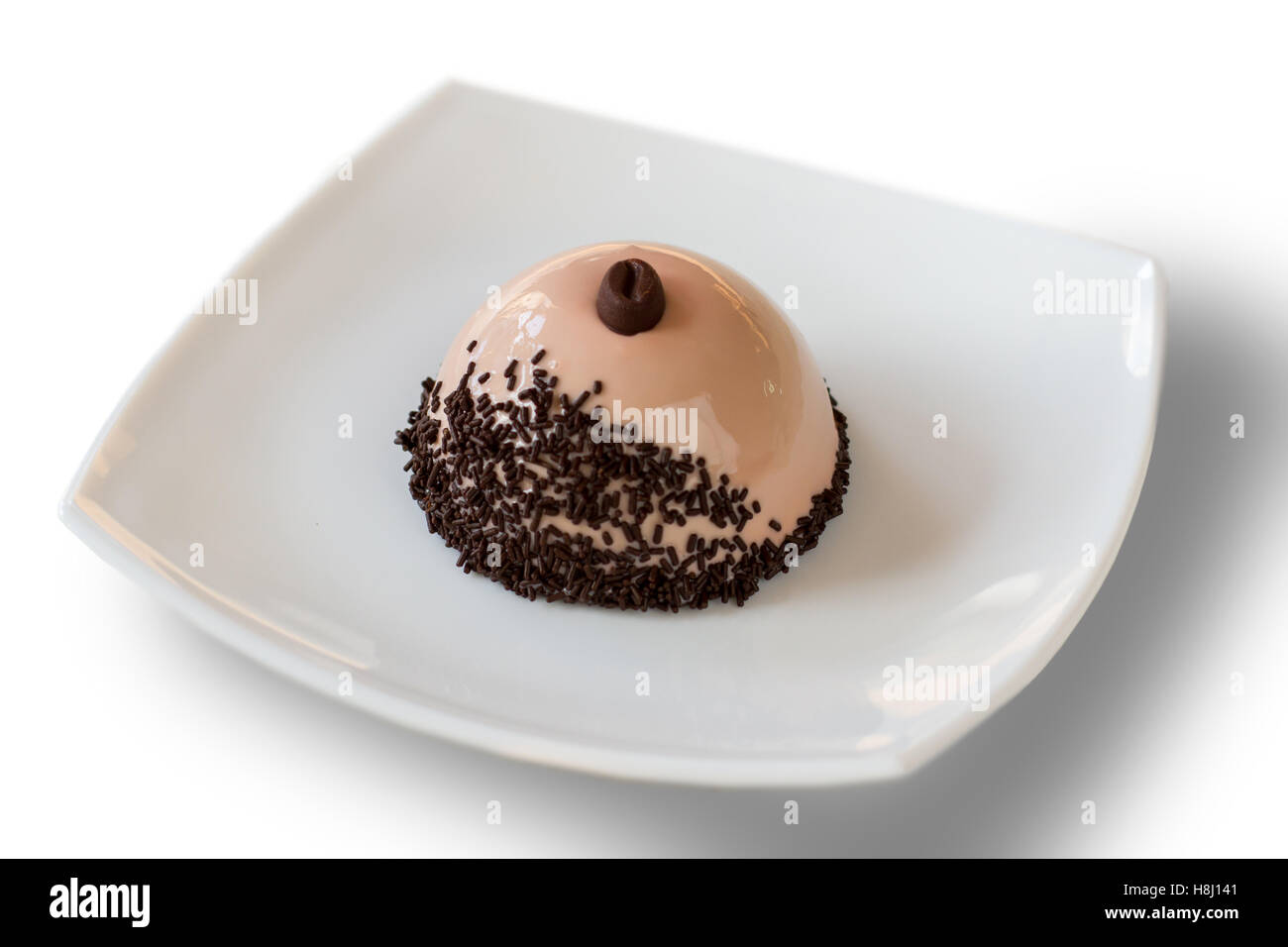 Dome shaped dessert on plate. - Stock Image