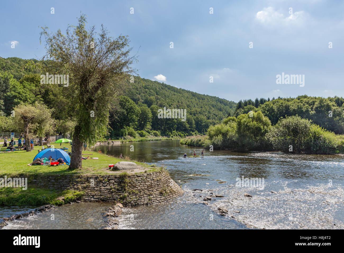 Recreating people near the riverbank at the river Semois, Belgium - Stock Image
