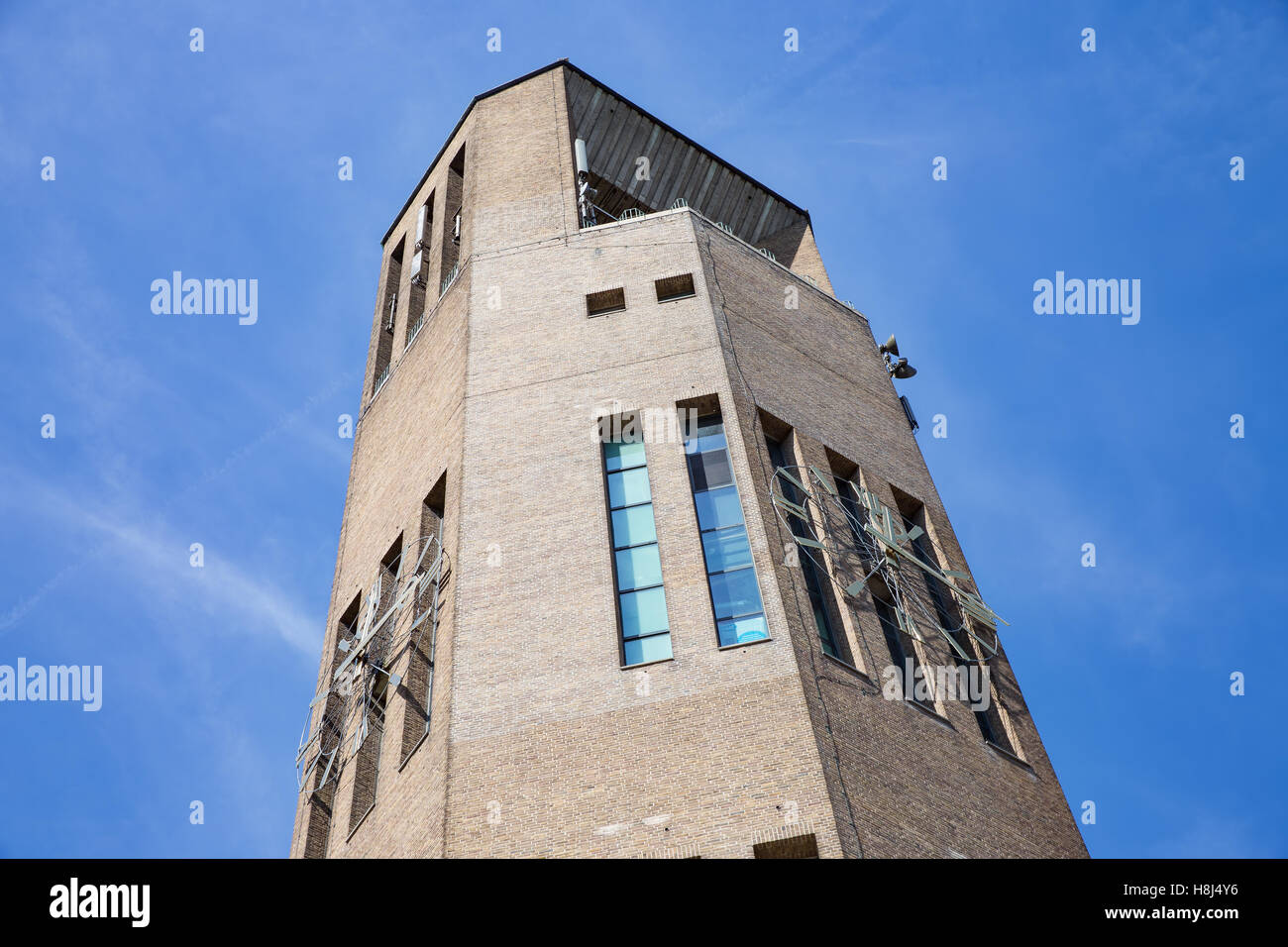 Big brick stone tower with clock in Emmeloord, the Netherlands - Stock Image