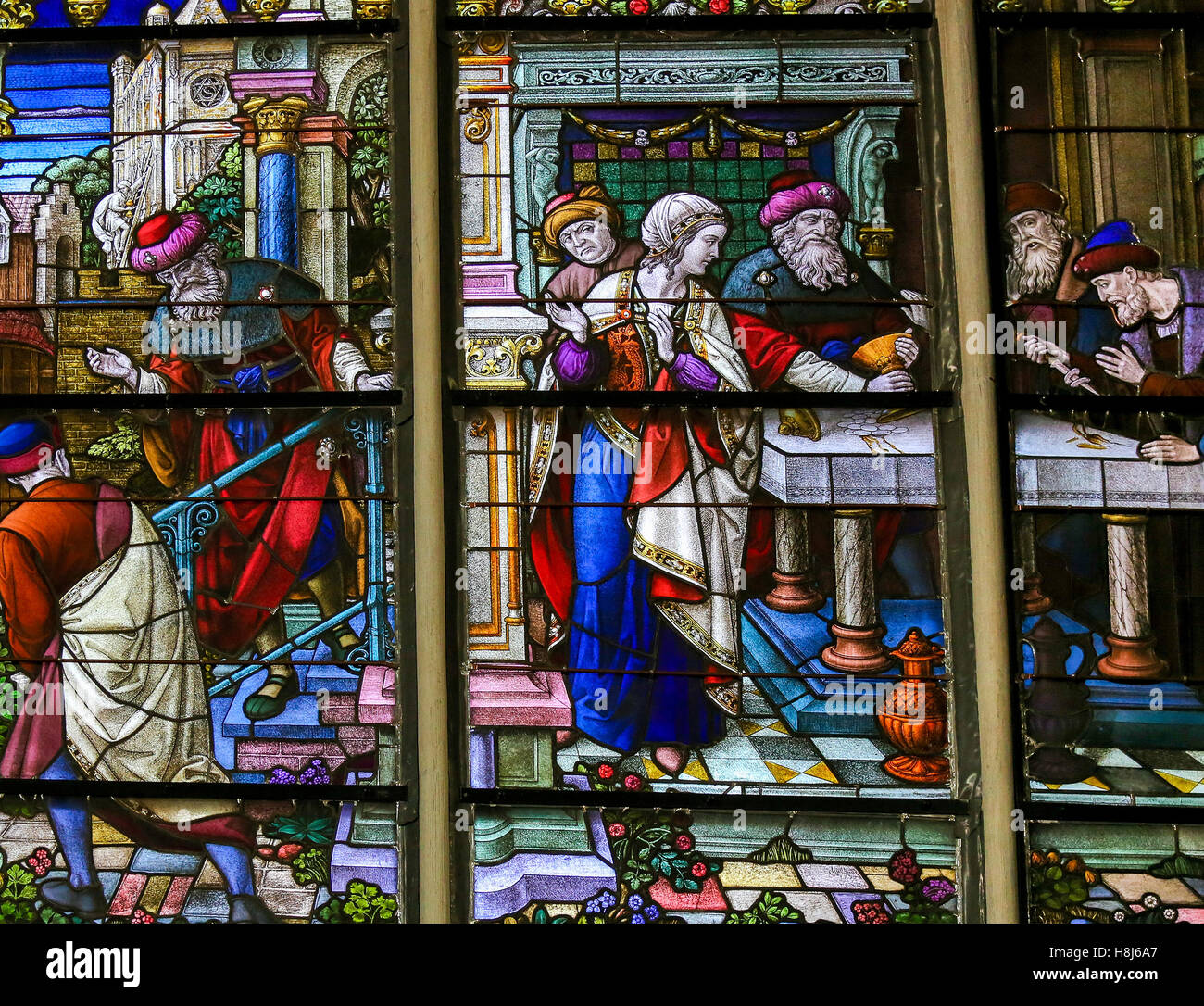 Stained Glass depicting the local legend of Jews stealing sacramental bread, in the Cathedral of Mechelen, Belgium. - Stock Image
