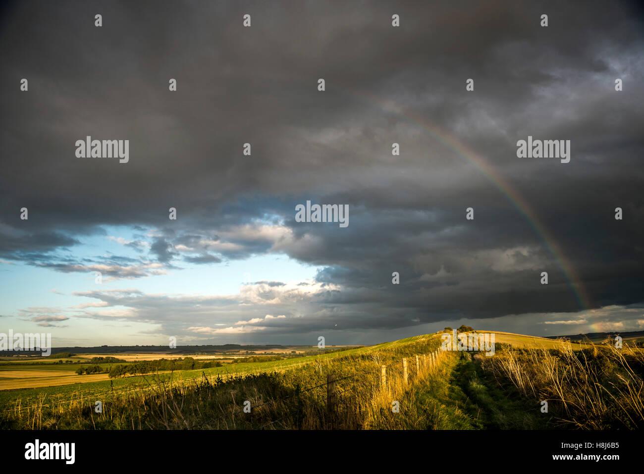 Rainbow over The Old Bath Road track near Cherhill, Wiltshire, UK Stock Photo