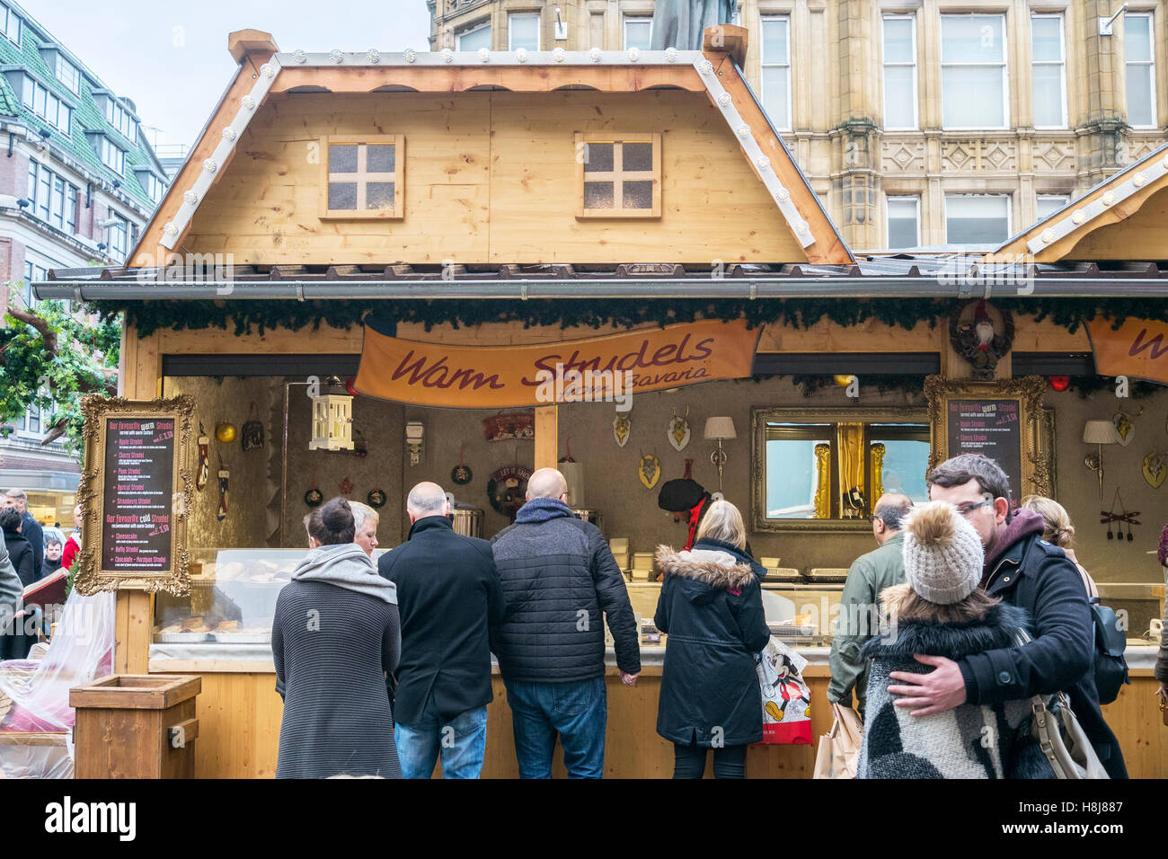 Temporary food stall as part of the Christmas markets in Manchester City centre, UK. - Stock Image