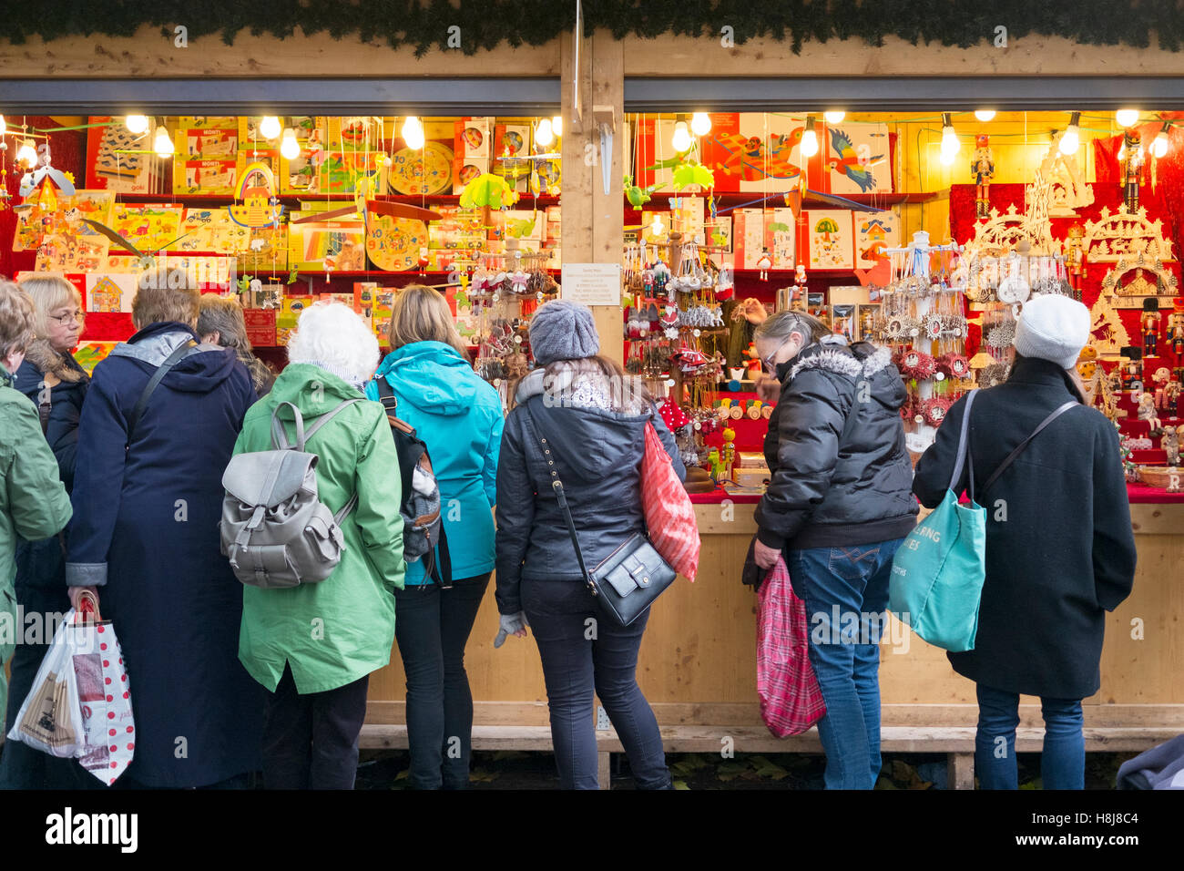 Temporary food stalls as part of the Christmas markets in Manchester City centre, UK. - Stock Image