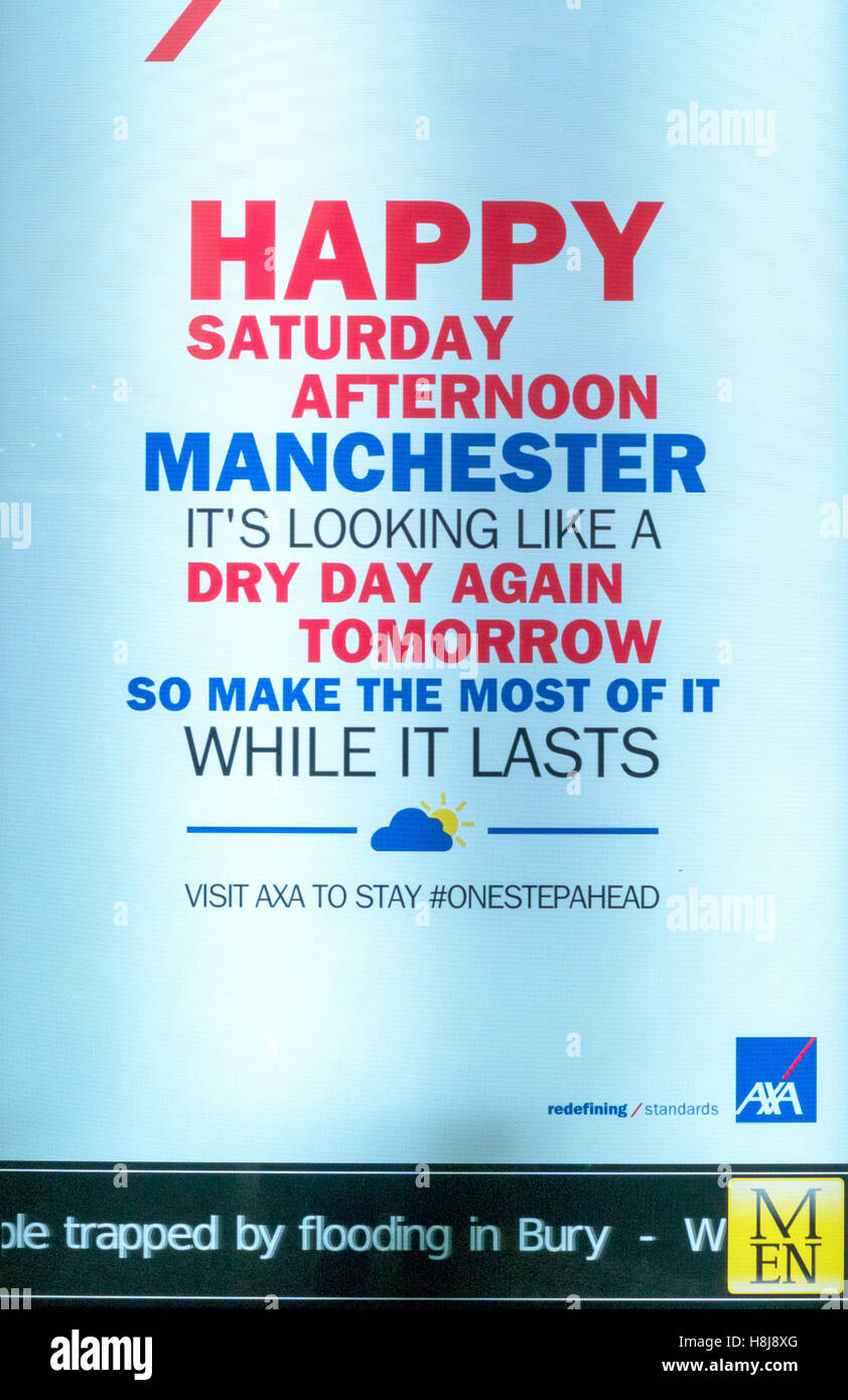 Information sign in Manchester quoting dry day again with 'flooding in Bury' along the bottom - Stock Image