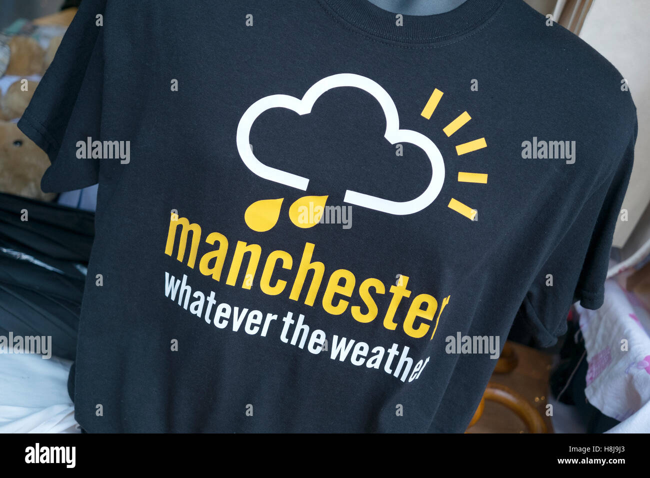 Manchester weather T-shirt for sale in the Christmas markets on Spinningfields, Manchester, UK - Stock Image