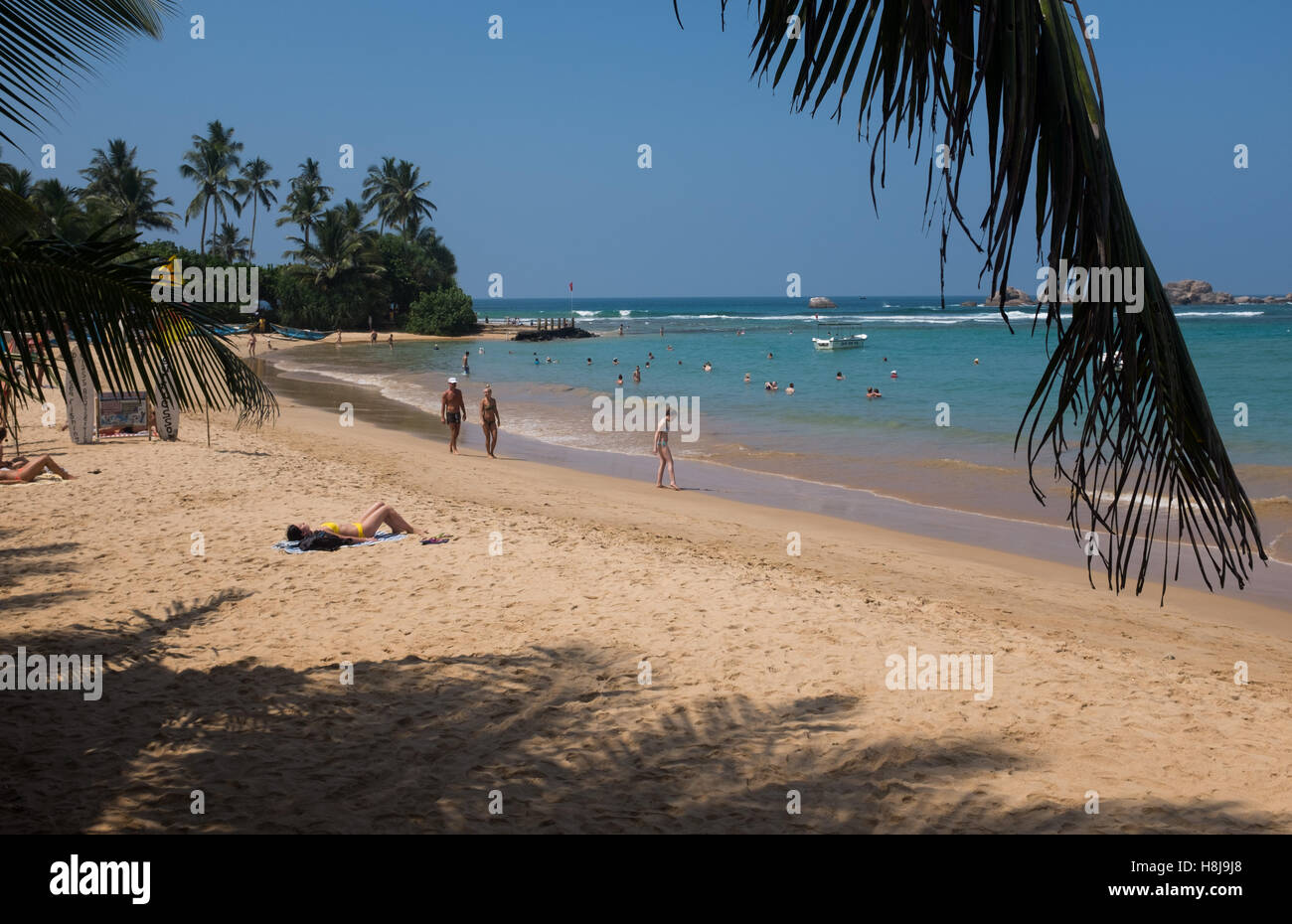 Tourists on a beach in Sri Lanka Stock Photo