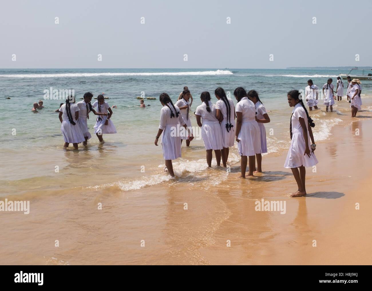 Schoolchildren playing on a beach in Sri Lanka - Stock Image