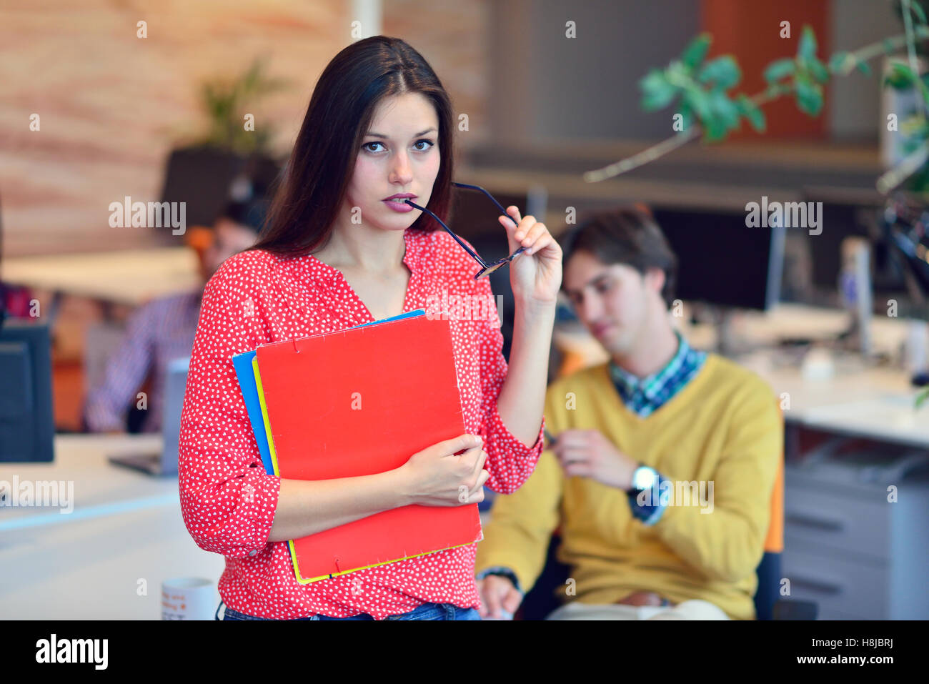 Young adults in training course using touchpad - Stock Image