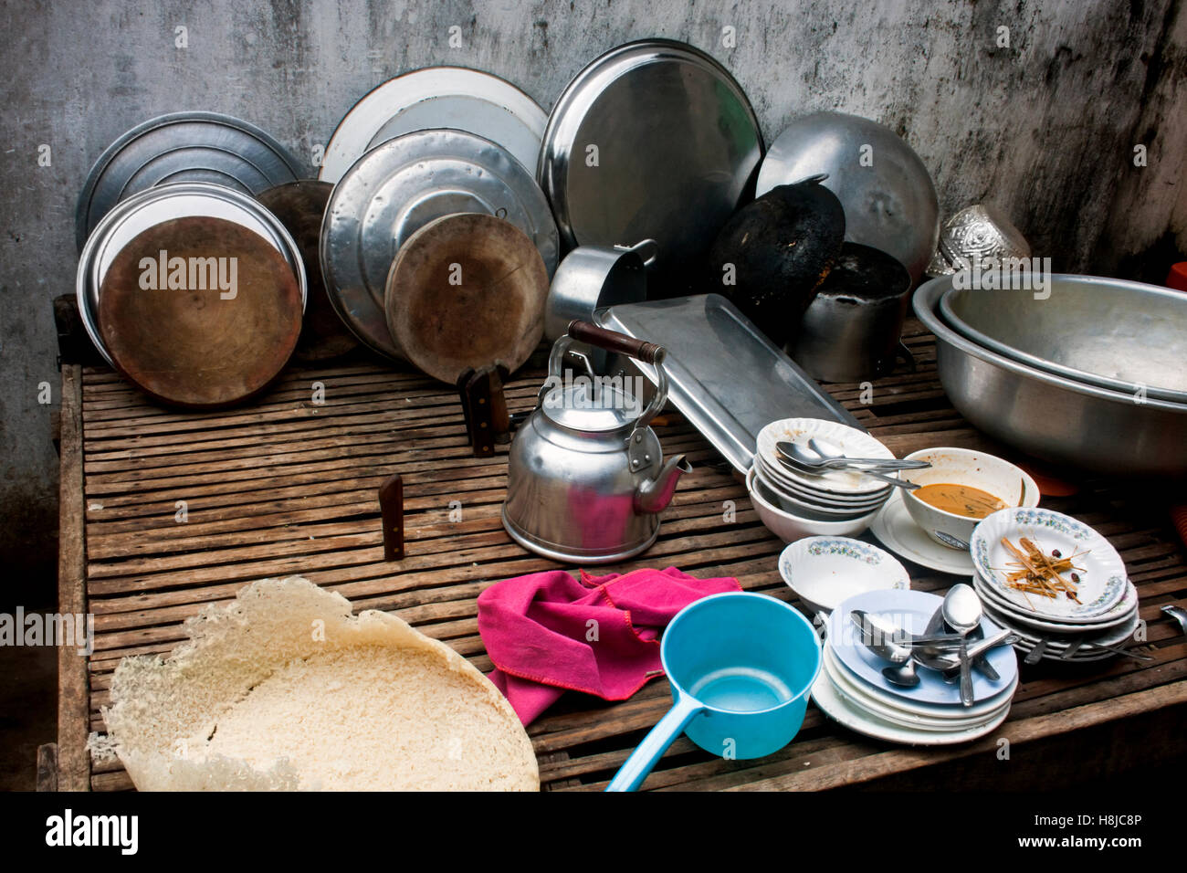 Pots And Pans Rest On A Table In A Kitchen At A Restaurant In Chork Village Cambodia Stock Photo Alamy