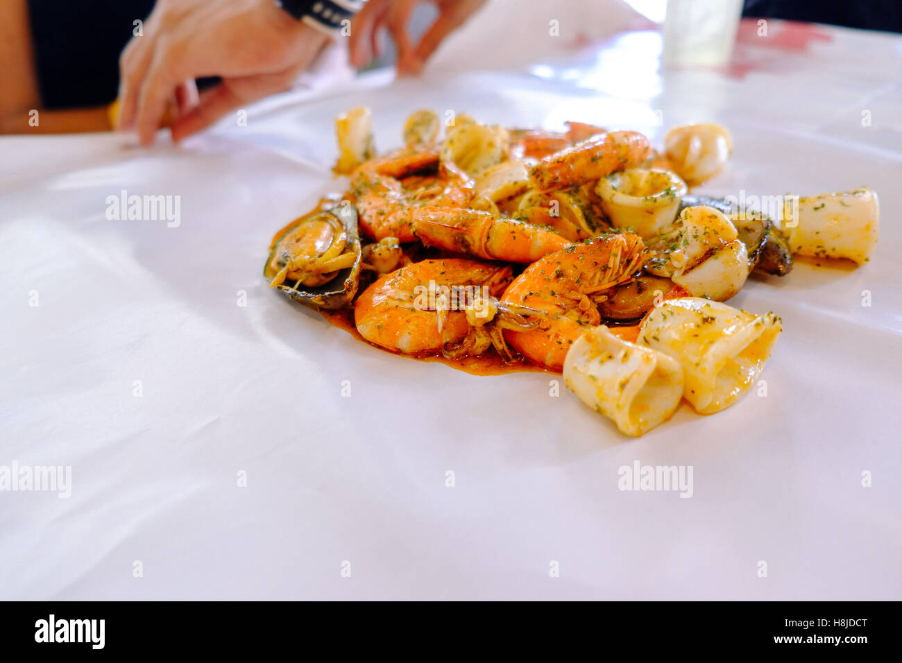 Crustacean seafood with mussels, oysters and shrimps on the table and white wax paper, selective focus, Food background. - Stock Image