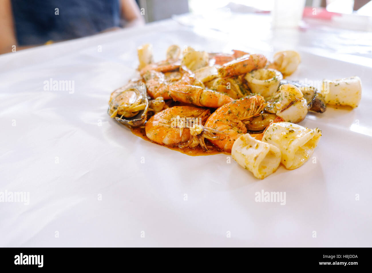 Crustacean seafood with mussels, oysters and shrimps on the table and white wax paper, selective focus, Food background. Stock Photo