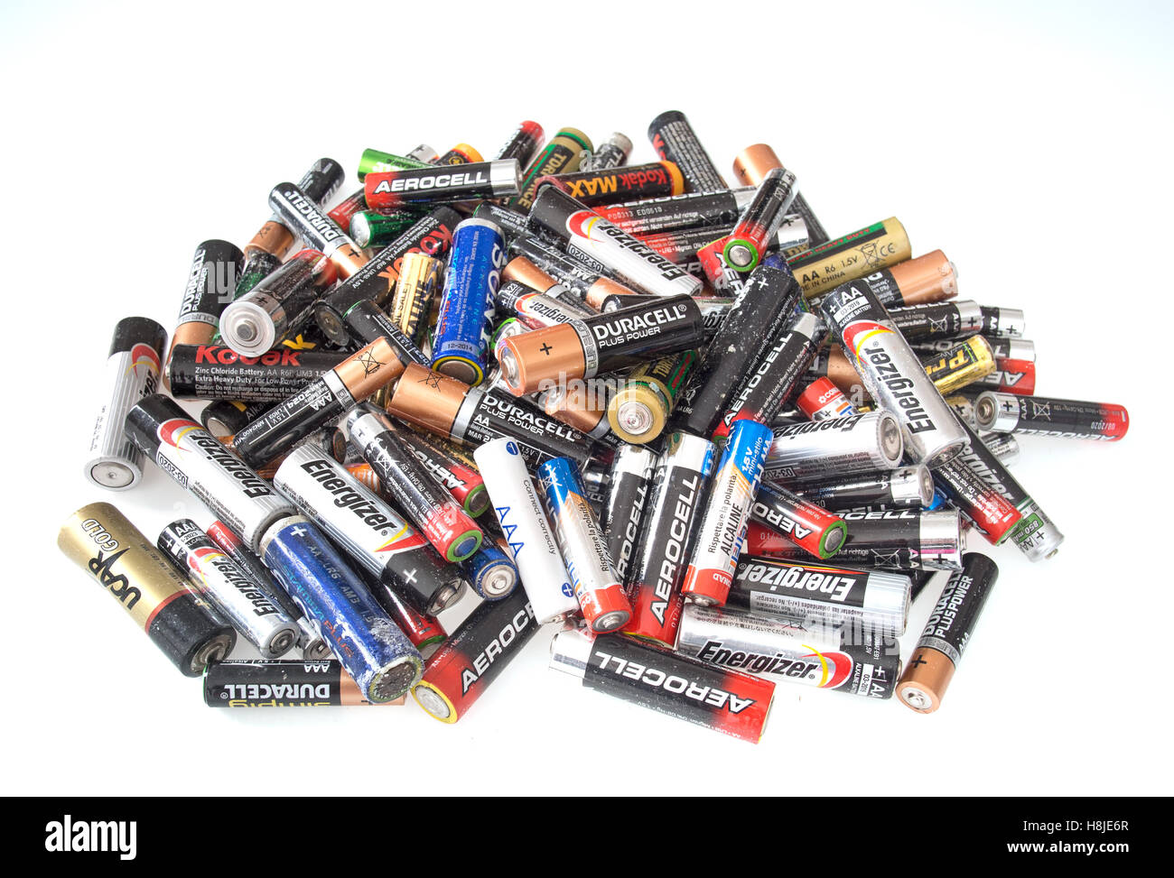 Old and corroded domestic small batteries, on white - Stock Image