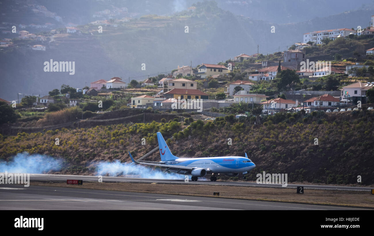 Thomson airplane landing at Funchal airport, Madeira - Stock Image