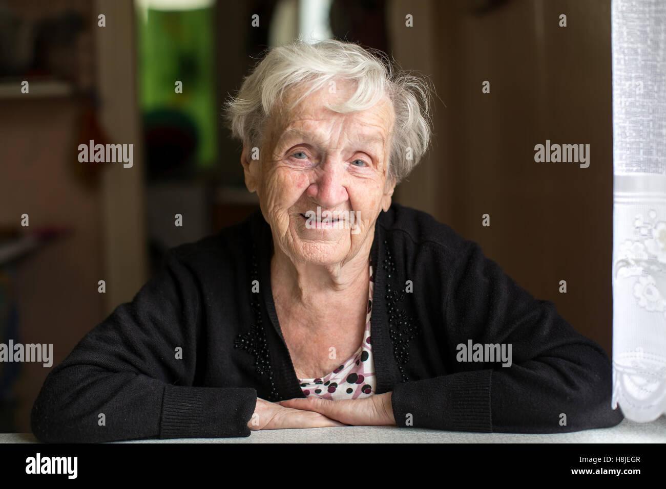 Portrait of a positive elderly woman (age 80-85) - Stock Image