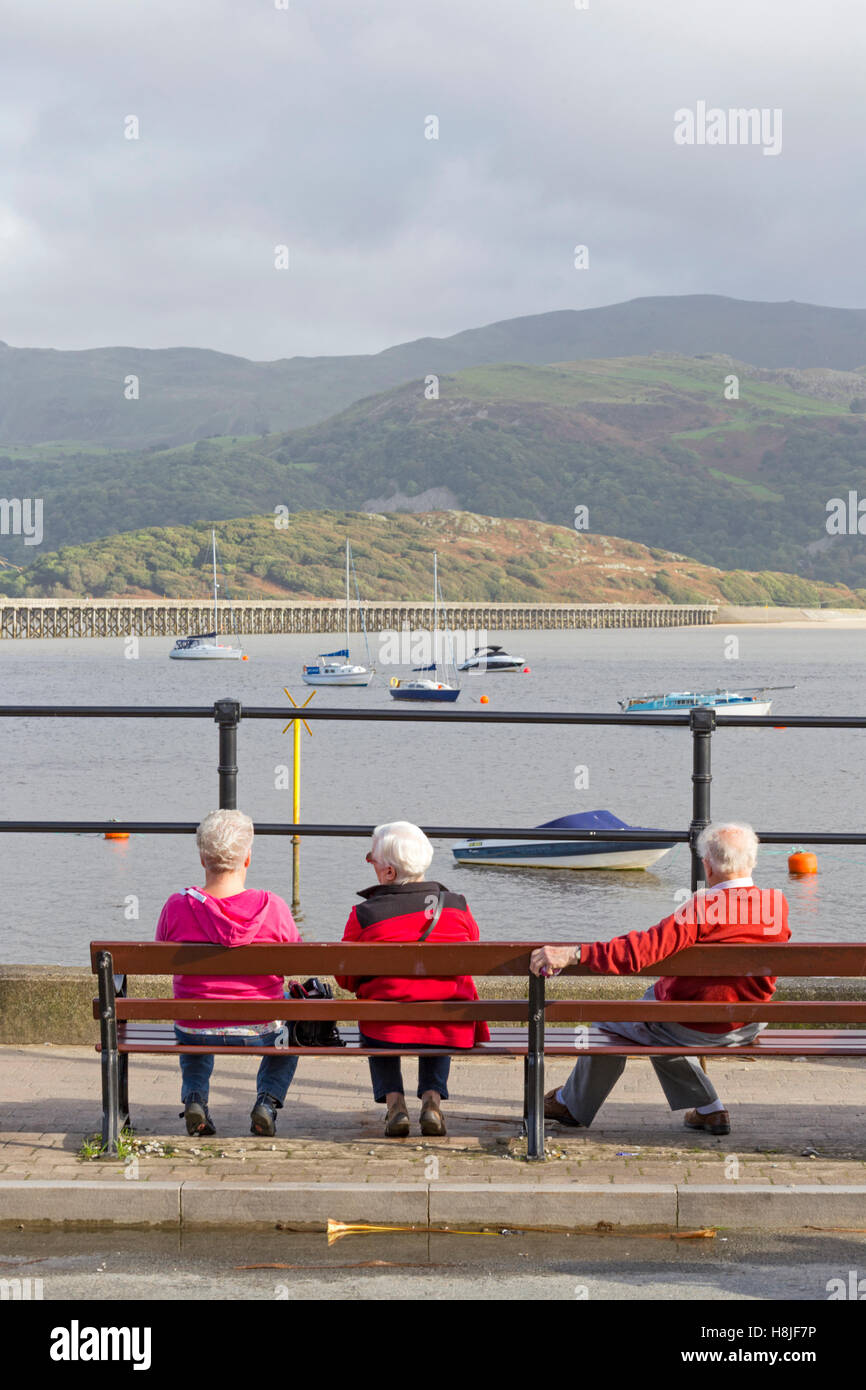 Elderly couples at the seaside town of Barmouth overlooking the Mawddach Estuary , North Wales, UK - Stock Image