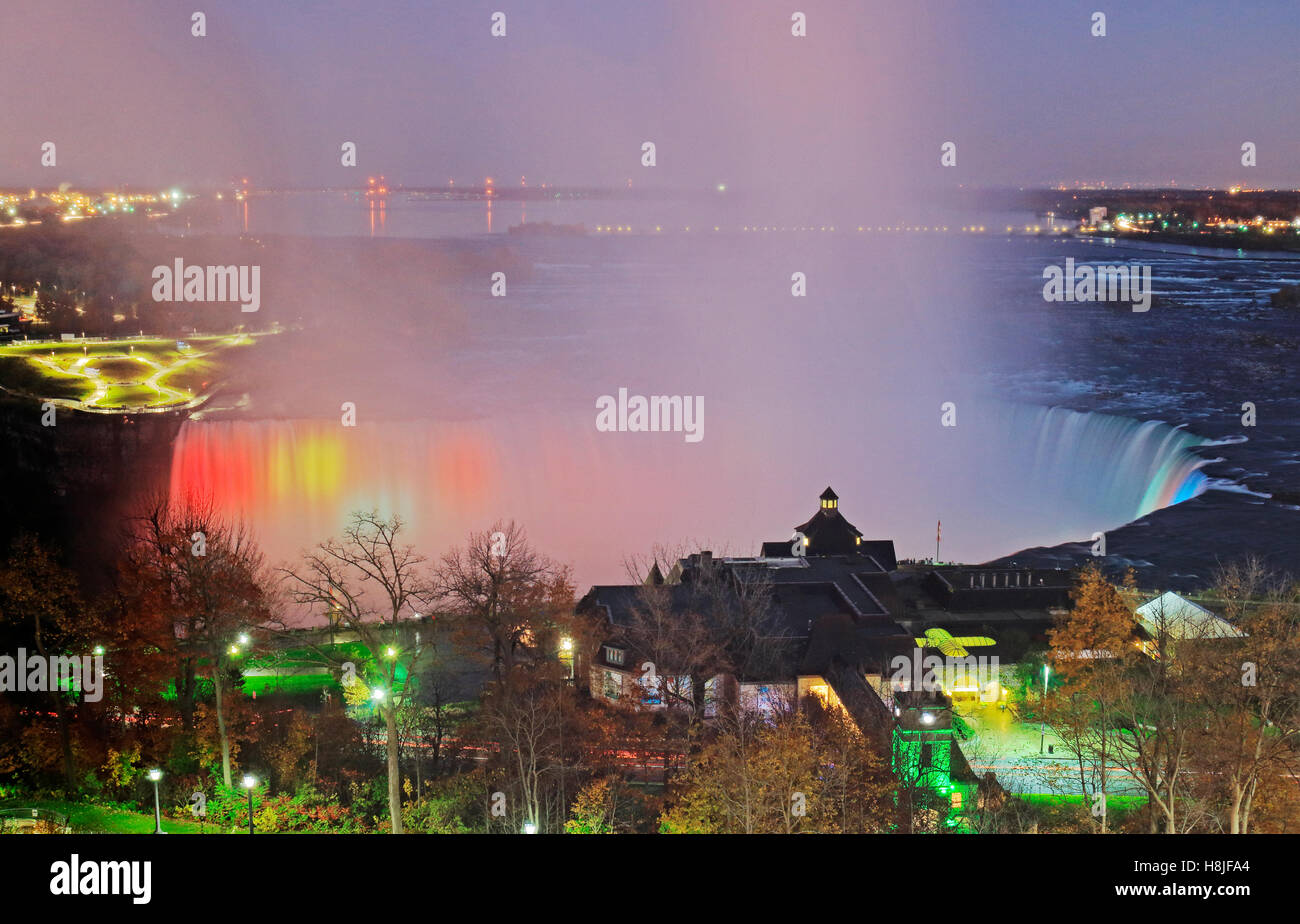 High angle view of Niagara Falls Illumination light show of the grand Horseshoe Falls and Table Rock Welcome Centre - Stock Image