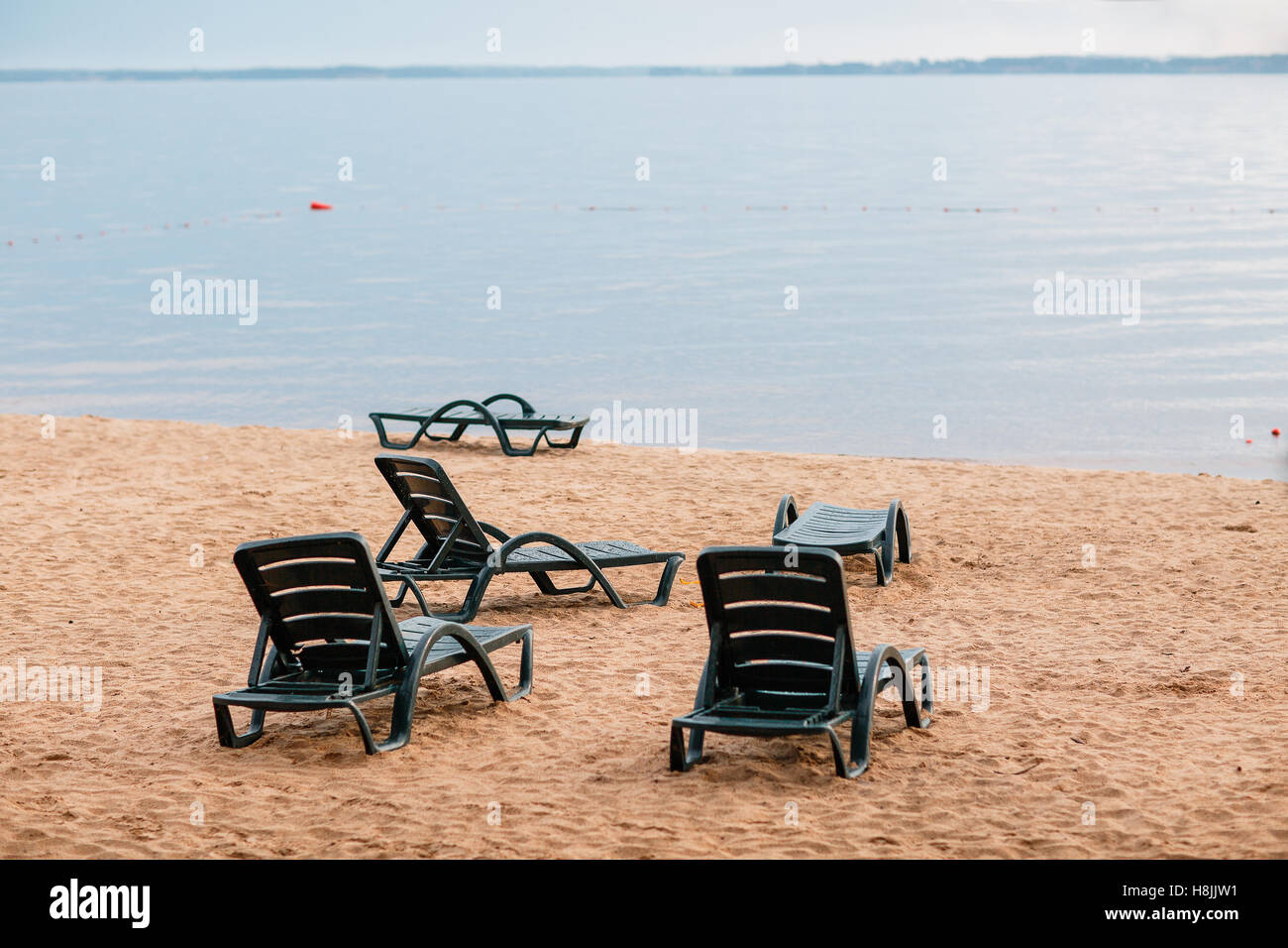 Sunbed on the beach after the rain. Mainly cloudy - Stock Image