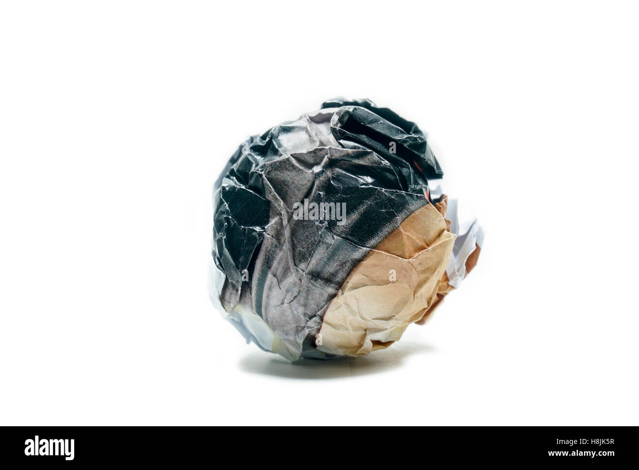 A screwed up piece of paper in ball shape., Crumpled sheet of paper isolated ., Junk paper can be recycle on white - Stock Image