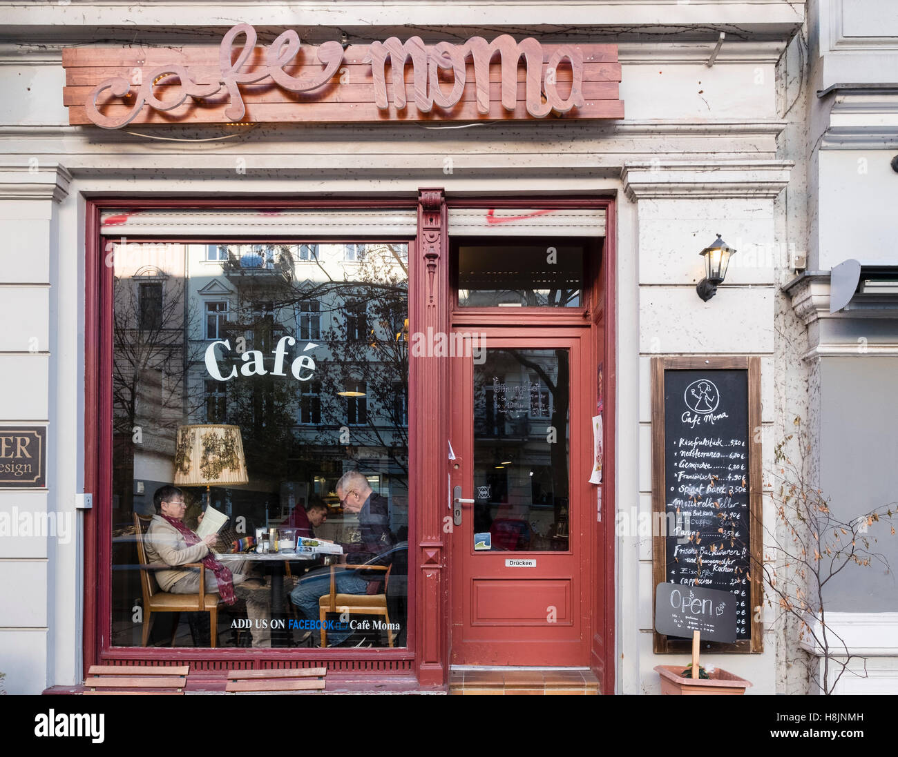 Small bohemian cafe in Prenzlauer Berg district of Berlin Germany - Stock Image