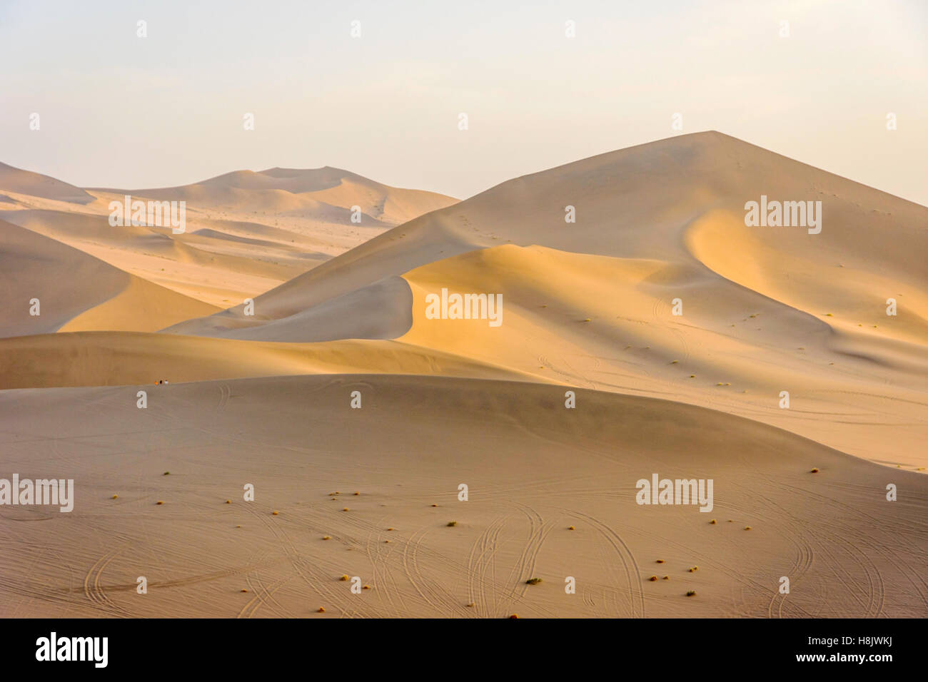 Colorful sand dunes in Gobi desert in afternoon sun, Dunhuang, China - Stock Image