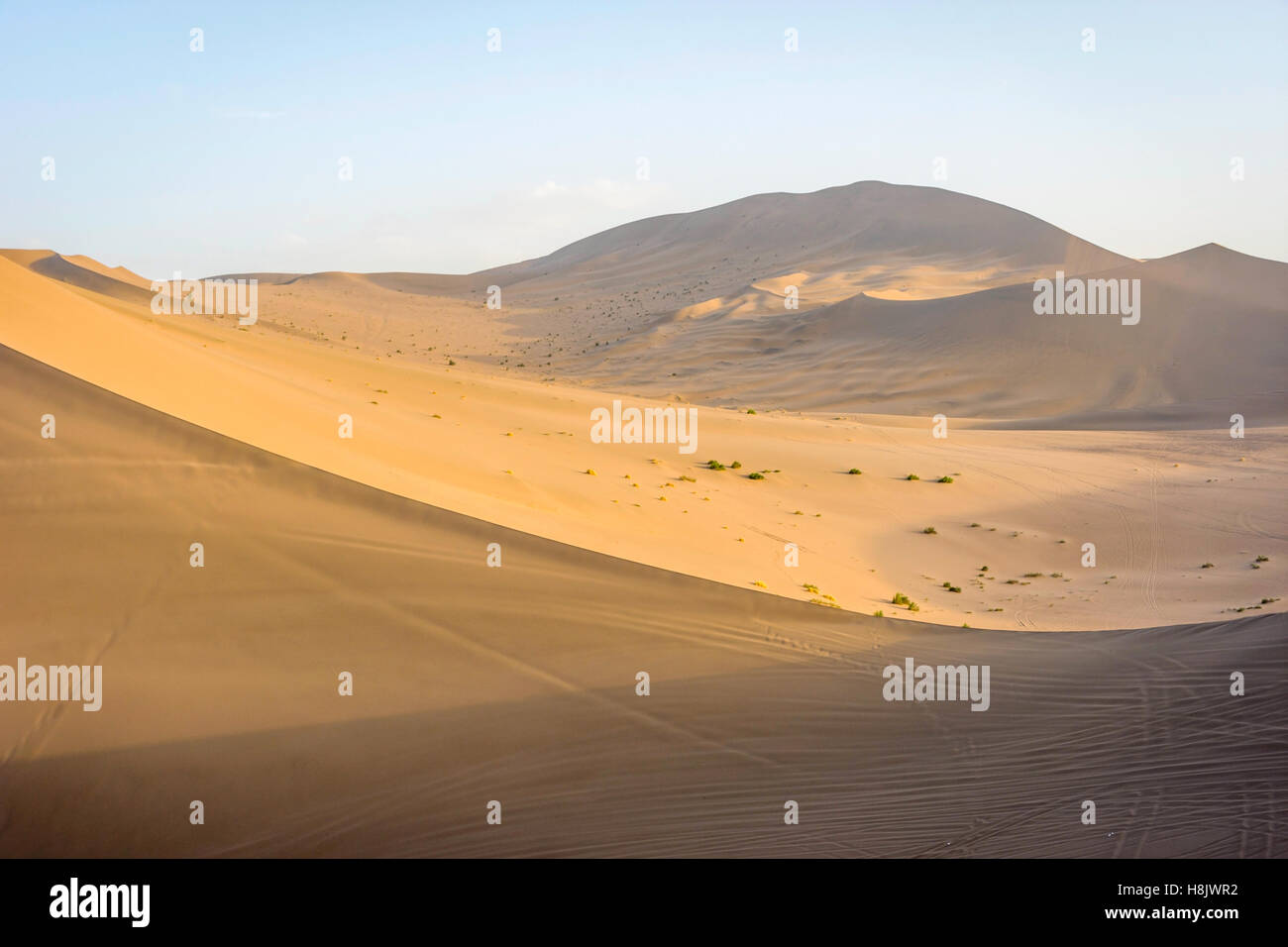 Colorful sand dunes in Gobi desert at sunset, Dunhuang, China - Stock Image