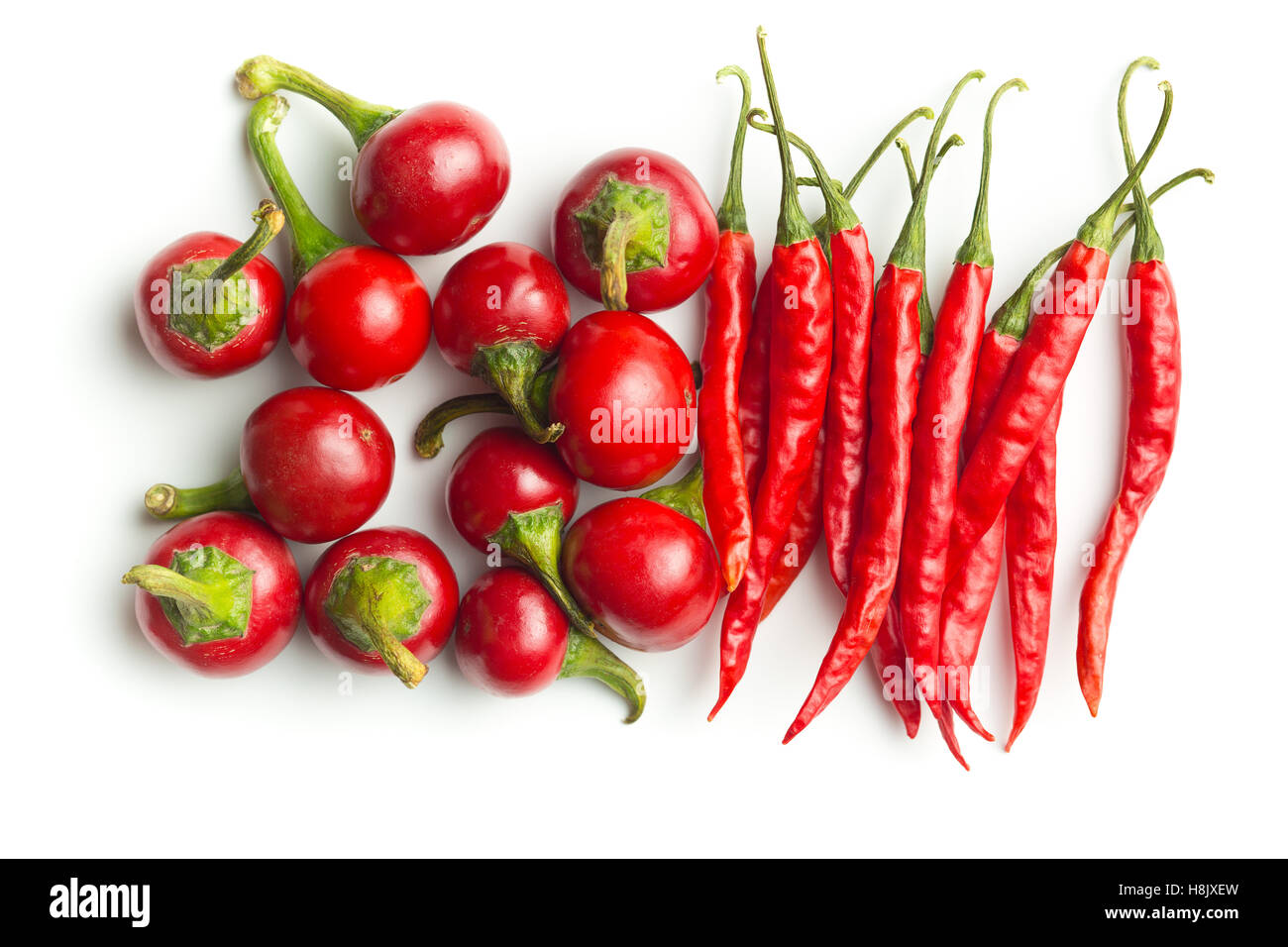 Round red chili peppers isolated on white background. - Stock Image