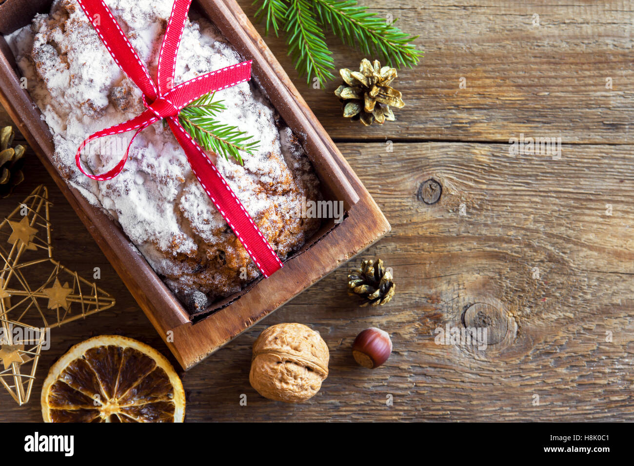 Traditional fruitcake for Christmas with decoration and ornaments - homemade Christmas pasrty Stock Photo