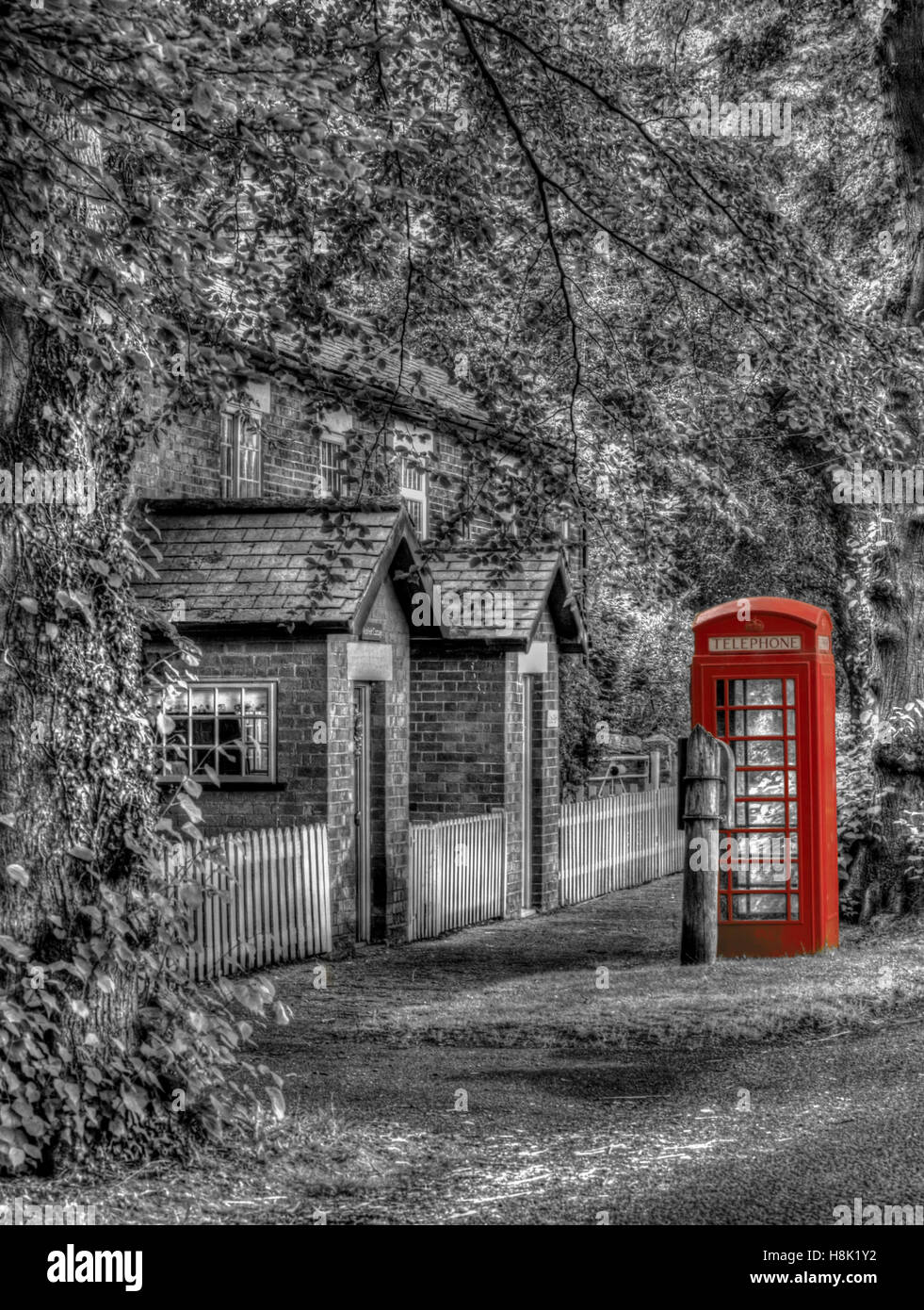 An old British telephone box. Such a rare sight these days. I decided to blend black and white with colour to give - Stock Image