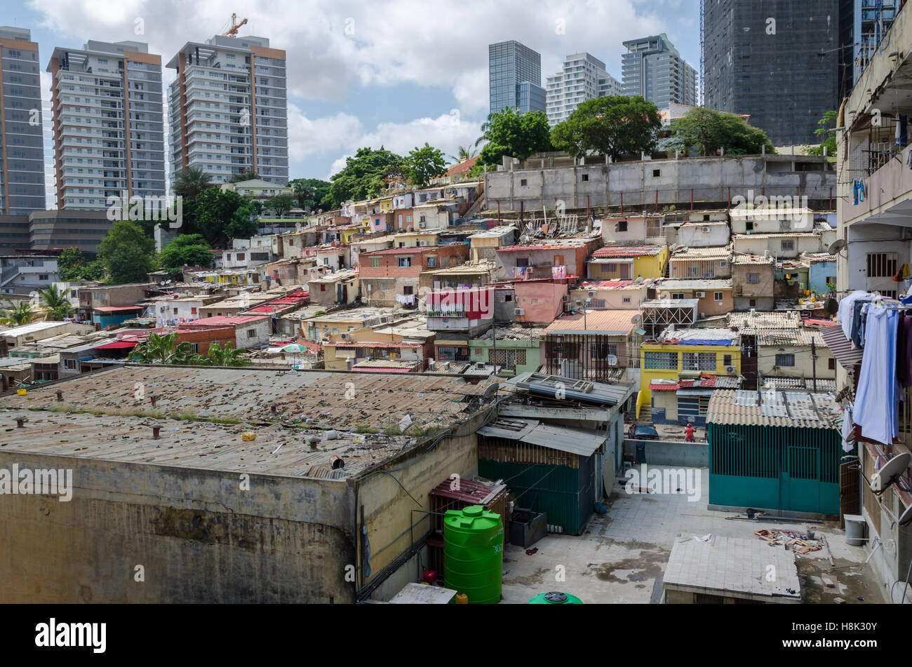 Colorful houses of the poor inhabitants of Luanda, Angola. These ghettos stand in stark contrast to the modern rich - Stock Image