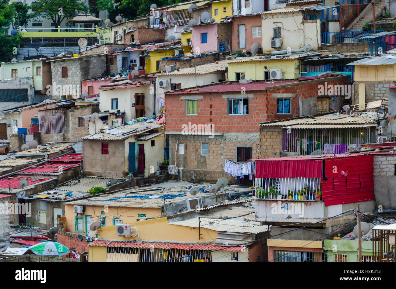 Colorful houses of the poor inhabitants of Luanda, Angola. These ghettos resemble Brasilian favelas. - Stock Image