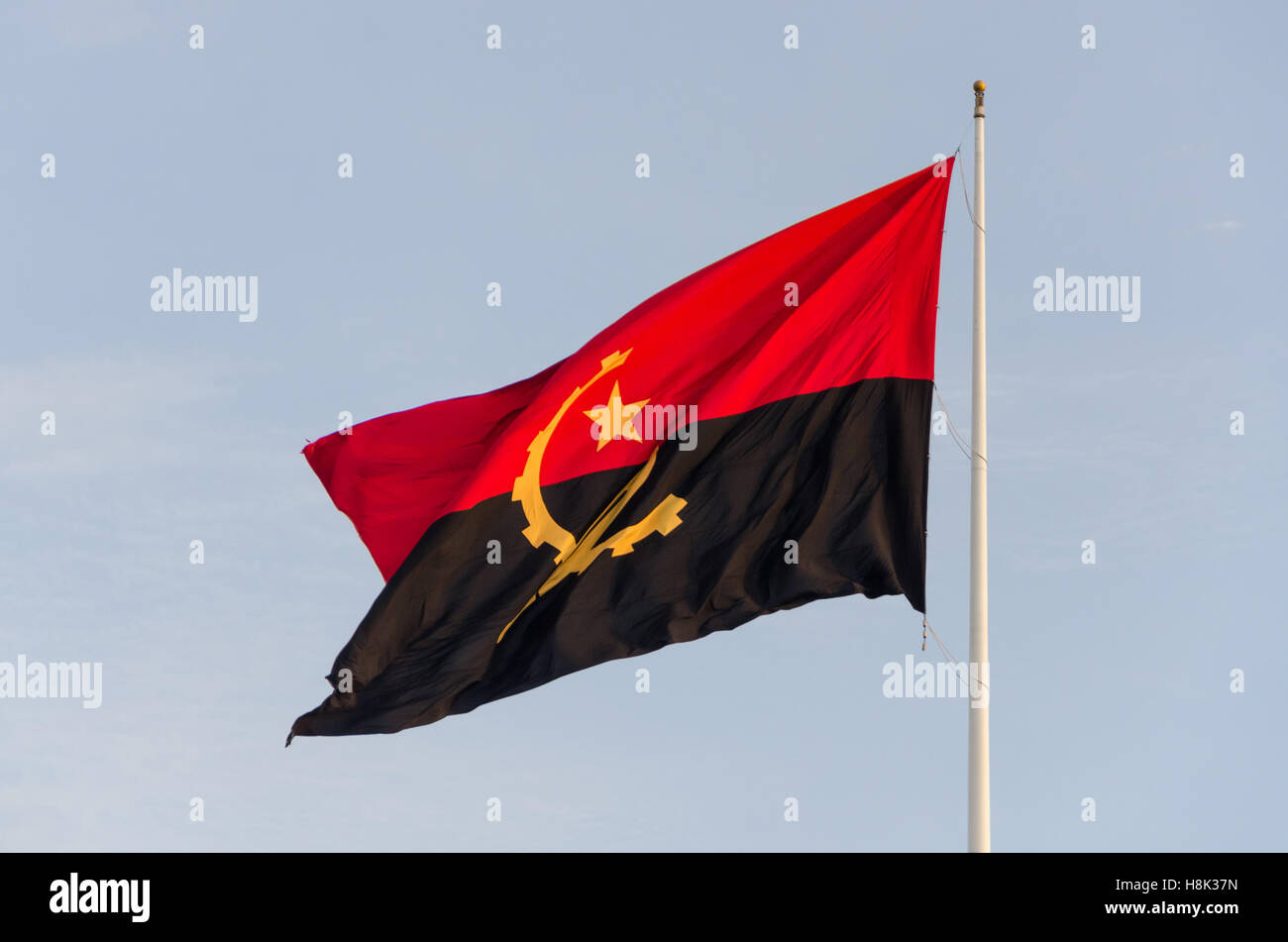 Flag of Angola flying at the Sao Miguel Fortress, Luanda. It is supposed to be one of the tallest flags in Africa. - Stock Image