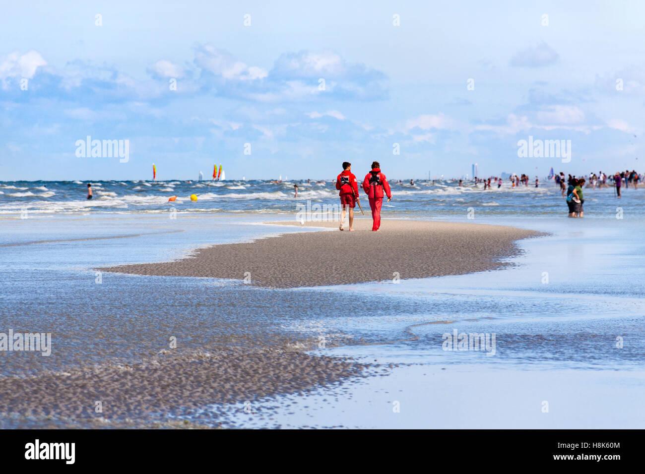 Two lifeguards patrolling the beach in the seaside resort of Middelkerke, Belgium Stock Photo